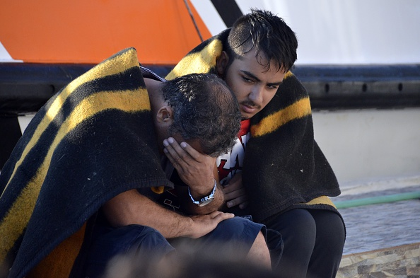 Illegal migrants who were trying to reach Greece's Kos island, are rescued by Turkish coast guard after their boat sank off Turkey's Aegean coast near Bodrum district of Mugla, western Turkey on August 18, 2015