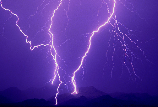 Dramatic cloud-to-ground lightning flashes with four strike points in Tortolita Mountains, Southern Arizona, USA