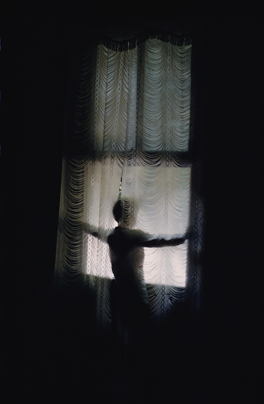 A figure stands looking out of a window at Agee House, home of the writer James Agee in Knoxville, Tenn., in 1962.