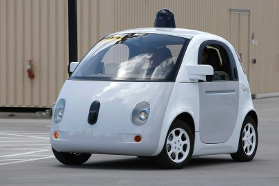 Google's new self-driving prototype car drives around a parking lot during a demonstration at Google campus on May 13, 2015, in Mountain View, Calif.