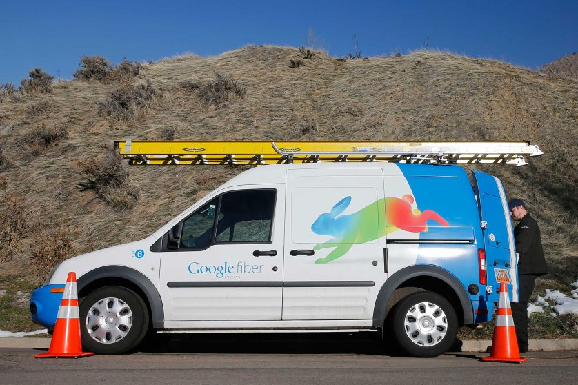 A Google Fiber technician gets supplies out of his truck to install Google Fiber in a residential home in Provo, Utah, January 2, 2014. Provo is one of three cities Google is currently building and installing gigabit internet and television service for business and residential use.