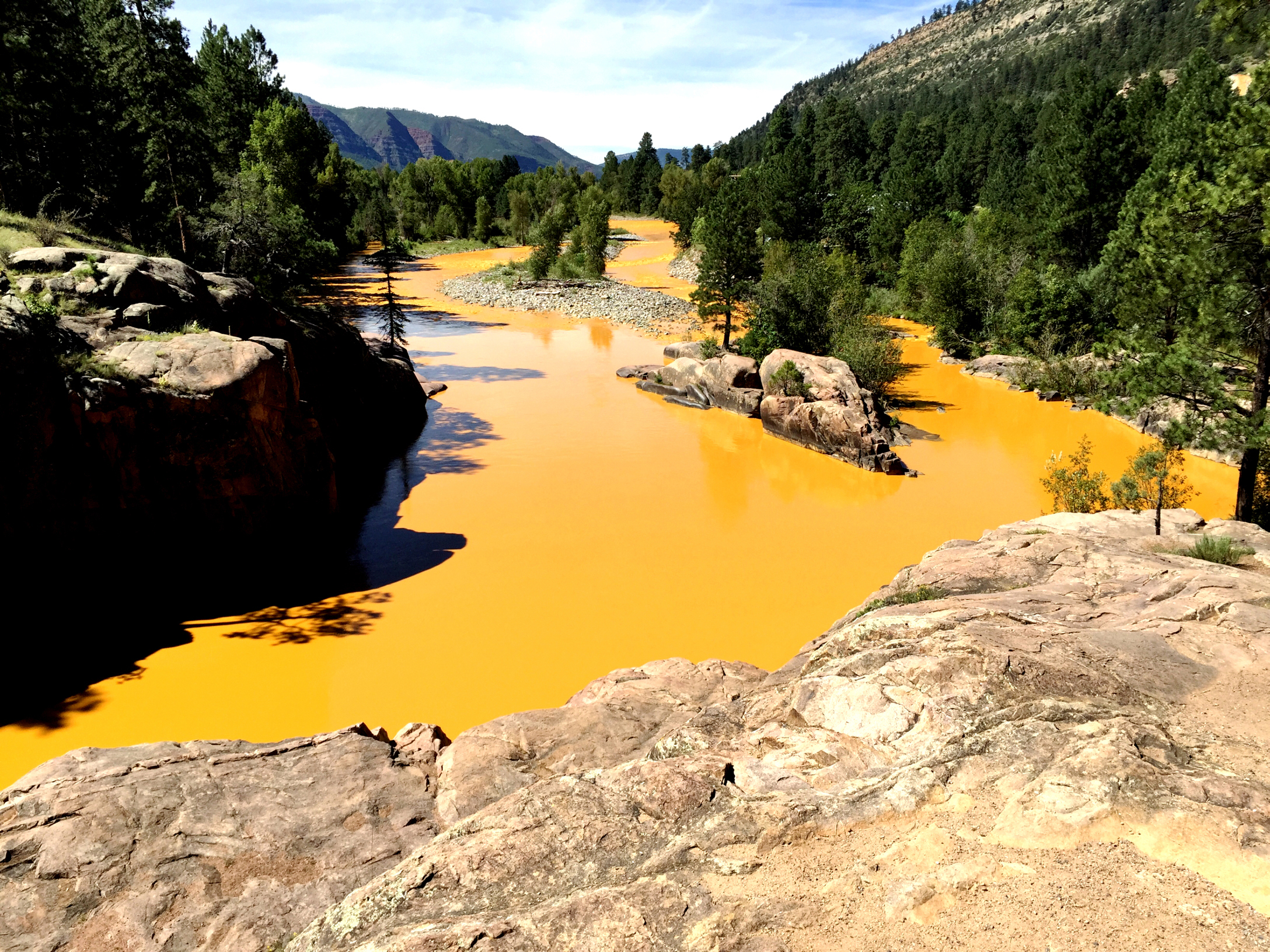 Mine waste from the Gold King Mine north of Silverton fills the Animas River at Bakers Bridge on Aug. 6, 2015 in Durango, Colo.