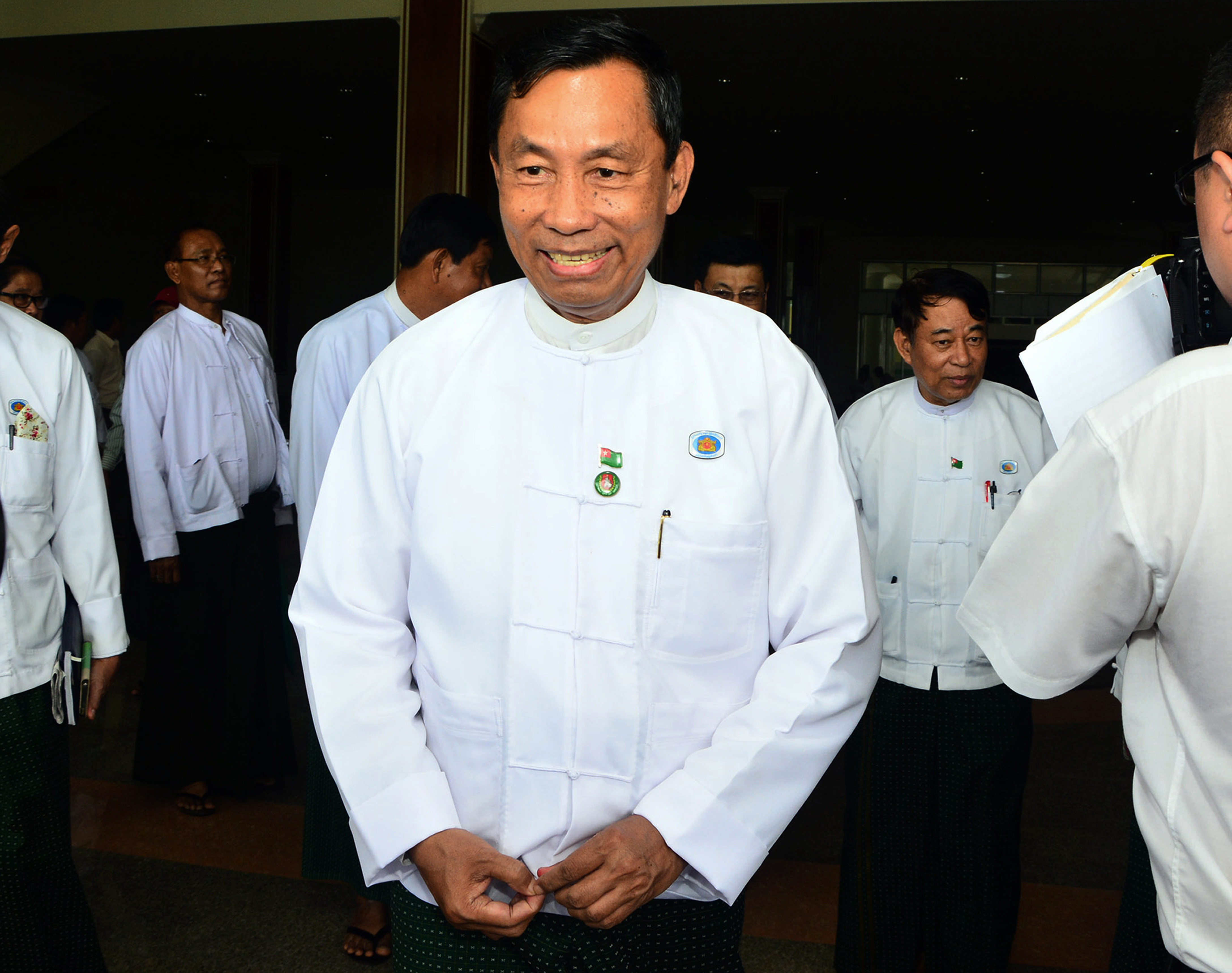 In this  Wednesday, Aug 12, 2015, photo, Burma's Parliament speaker Shwe Mann leaves after a press conference at the Union Solidarity and Development Party headquarters in Naypyitaw.