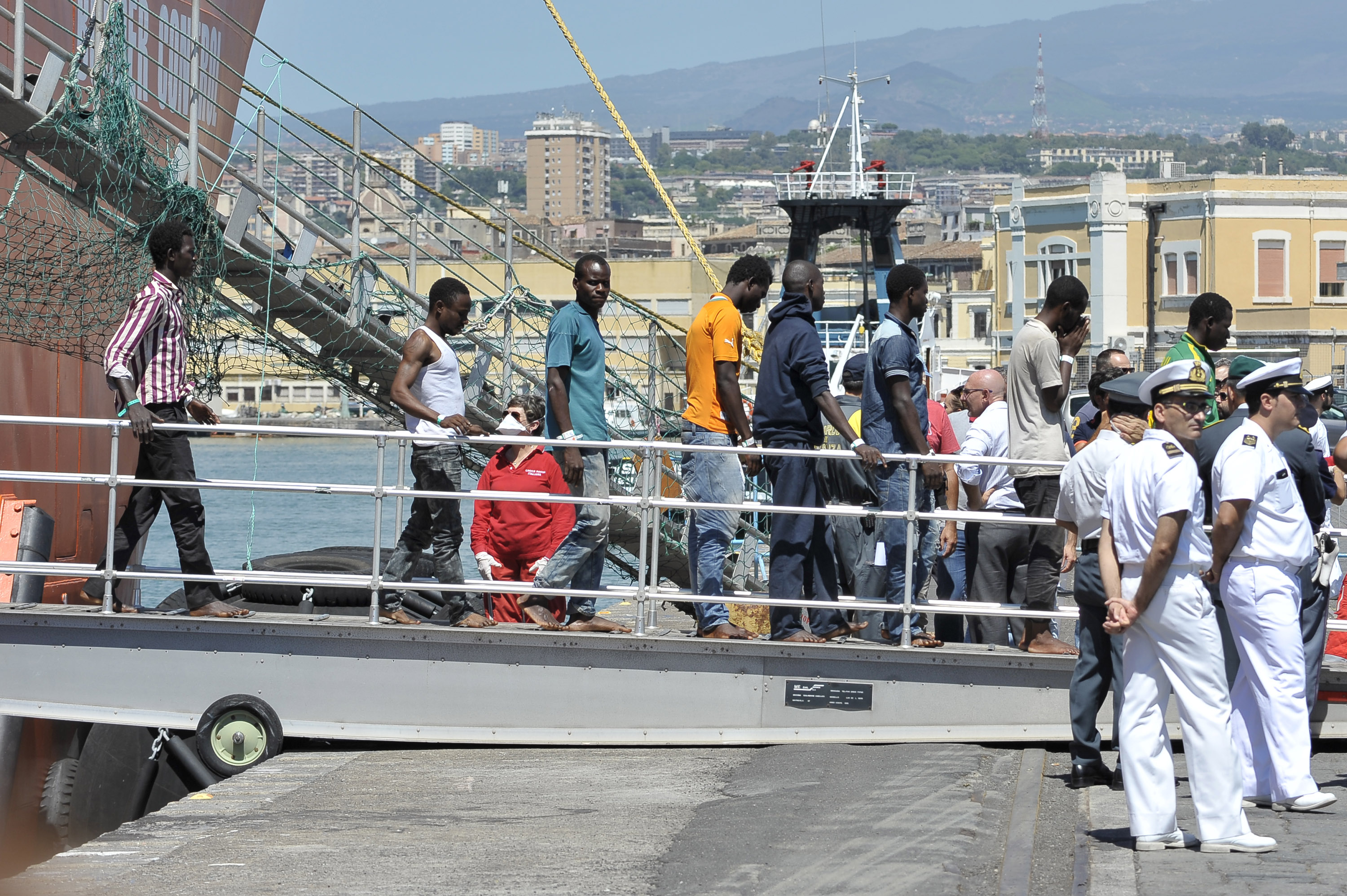 Migrants disembark from the Norwegian ship Siem Pilot at Catania harbor, Italy, Monday, Aug. 17, 2015