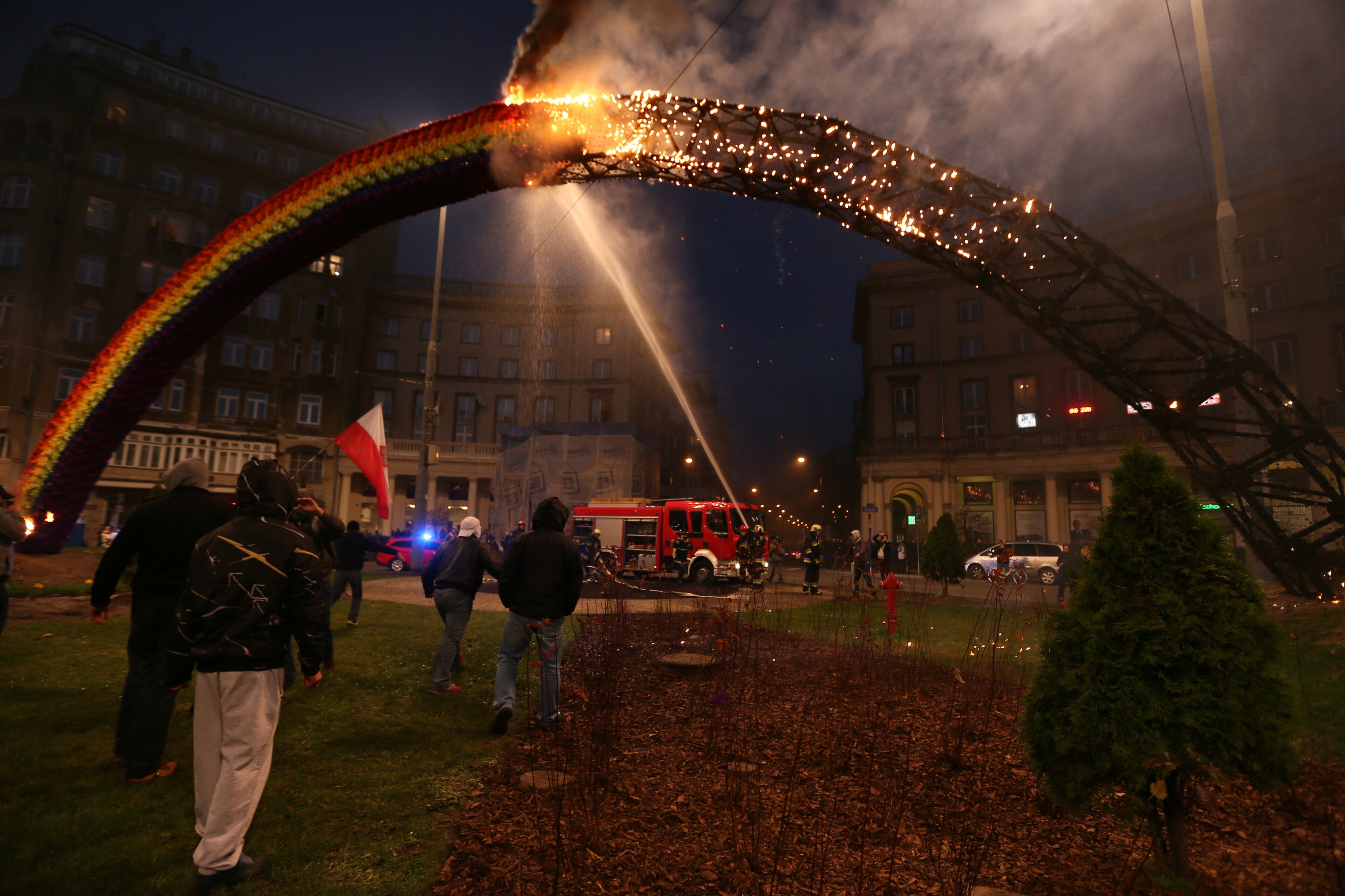 A 'Rainbow' installation is set on fire by demonstrators during the 'March of Independence' at the Savior Square in Warsaw, Poland, Nov. 11, 2013