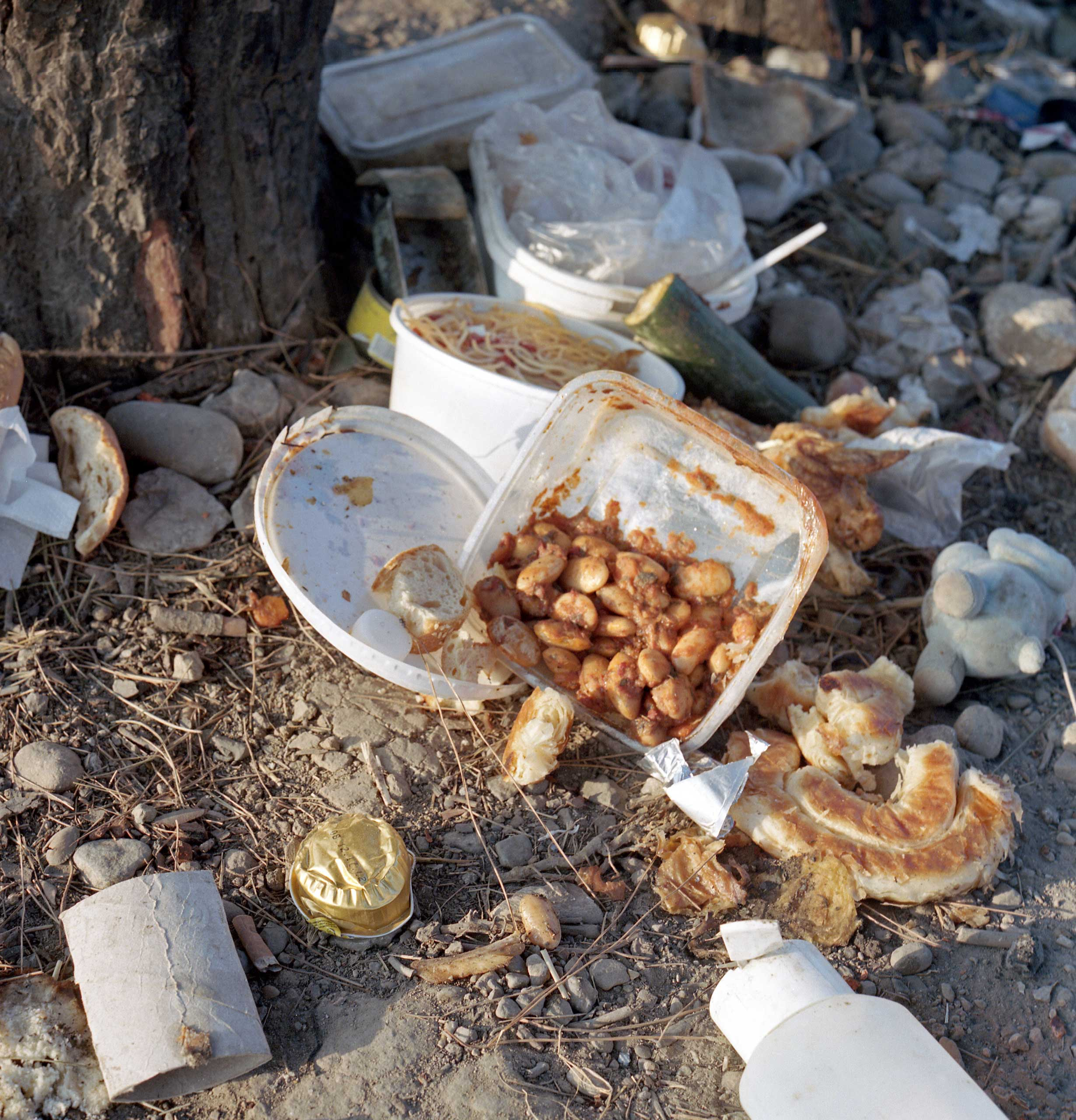 Left-overs of food used by refugees waiting in Idomeni, a town by the Greek-Macedonian border where roughly 400 people a day are waiting to cross into Macedonia to continue their journey into Western Europe. Greece, June 2015.