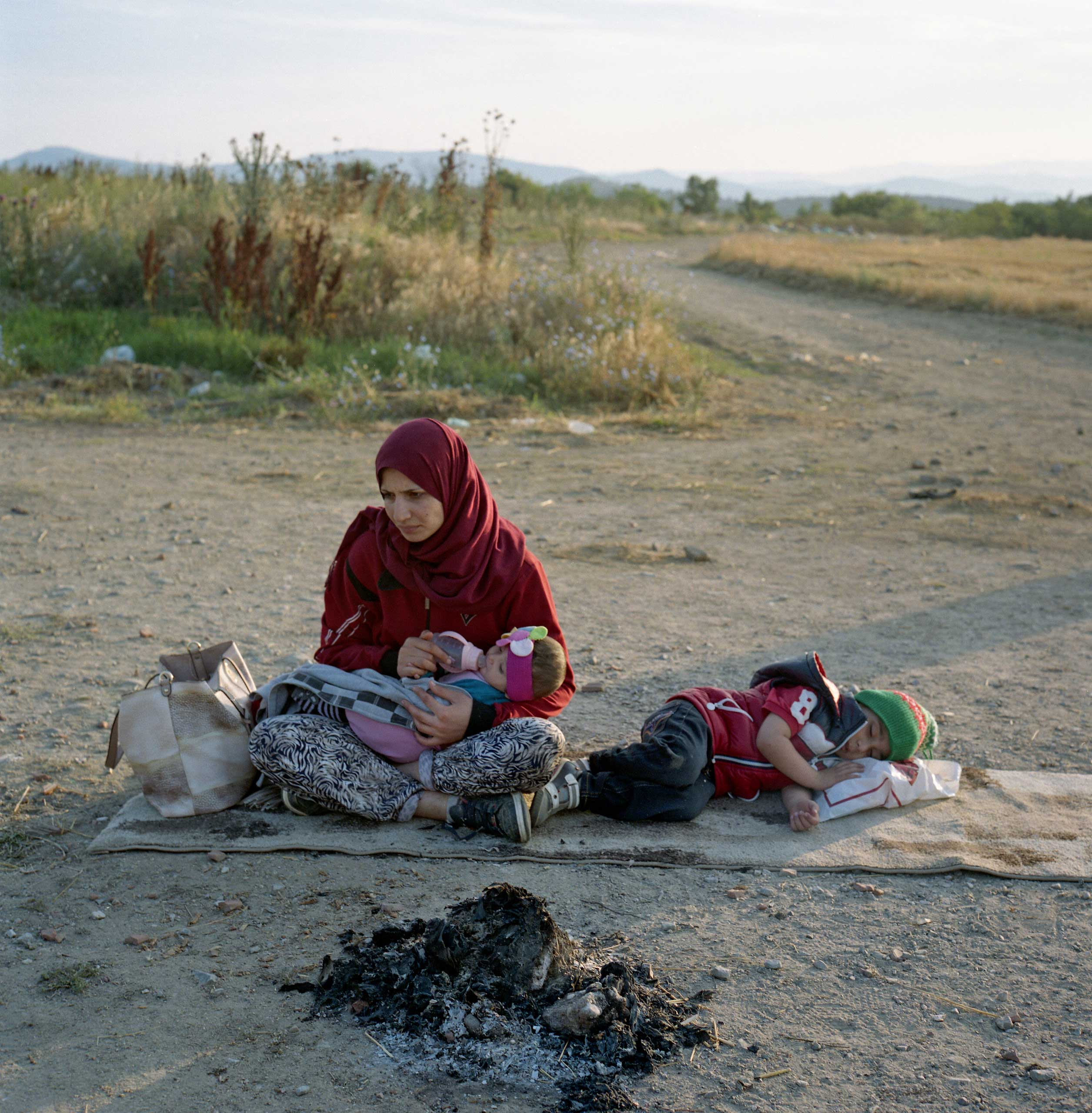 Syrian mother feeding her child as she waits along with her family for a chance to cross into Macedonia. According to International Organization for Migration, over 59,000 people have crossed into Greece in between January and May 2015, approximately 50% of migrants are from Syria. Greece, June 2015.