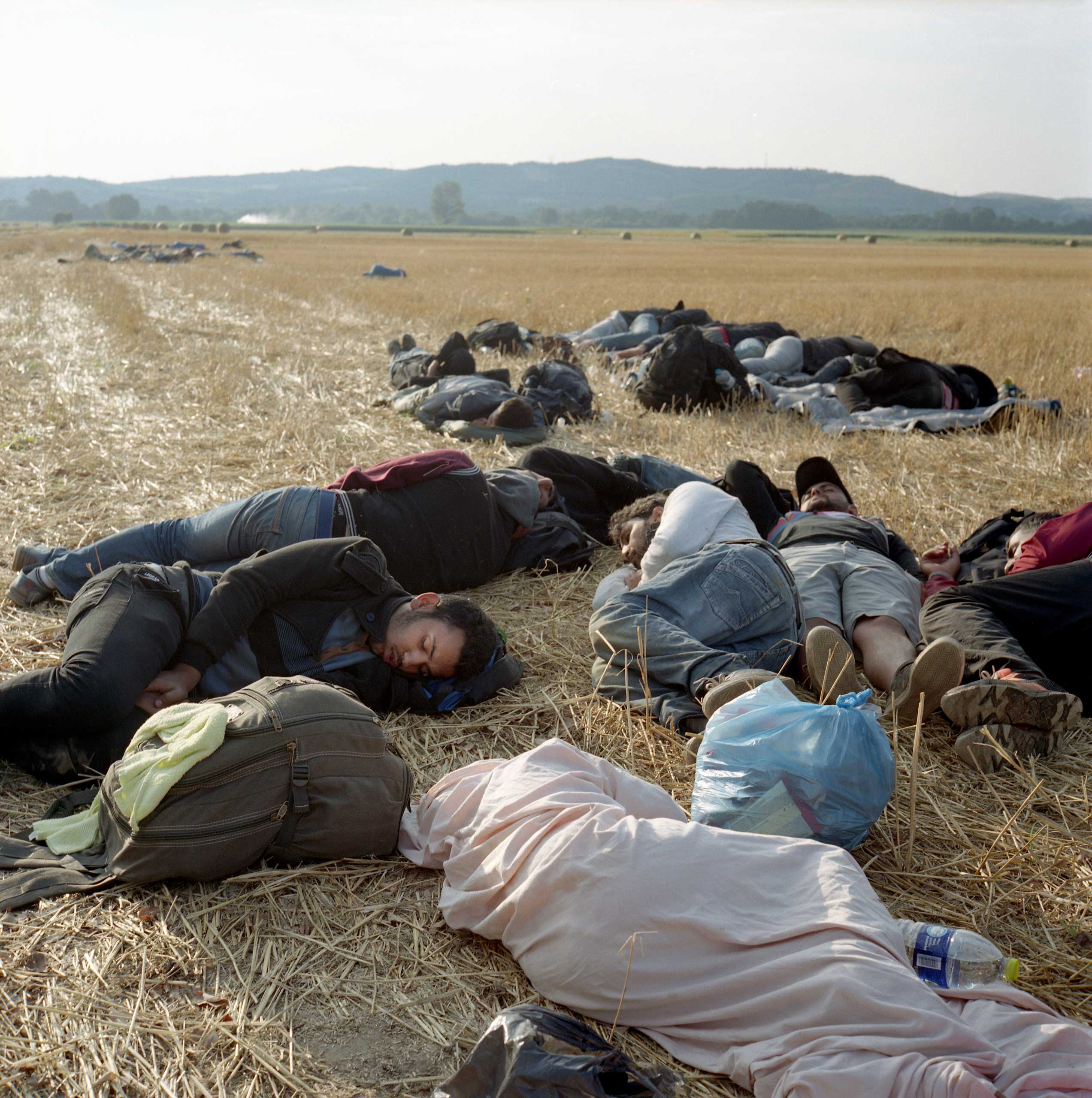 Refugees from Syria sleeping in the fields of Idomeni, a small town by the Greek-Macedonian border. Greece, June 2015.