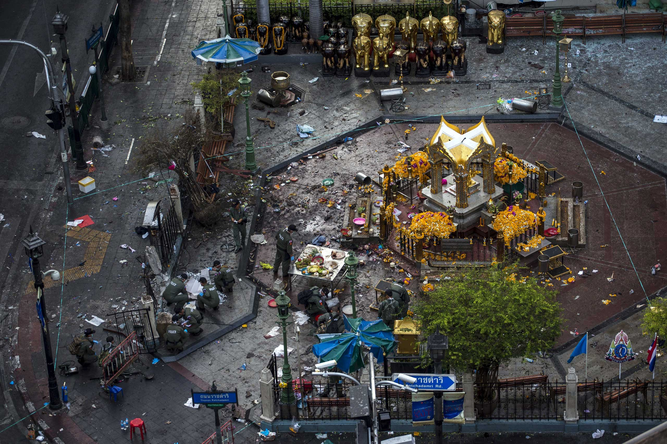 Experts investigate the Erawan shrine at the site of a deadly blast in central Bangkok, on Aug. 18, 2015.