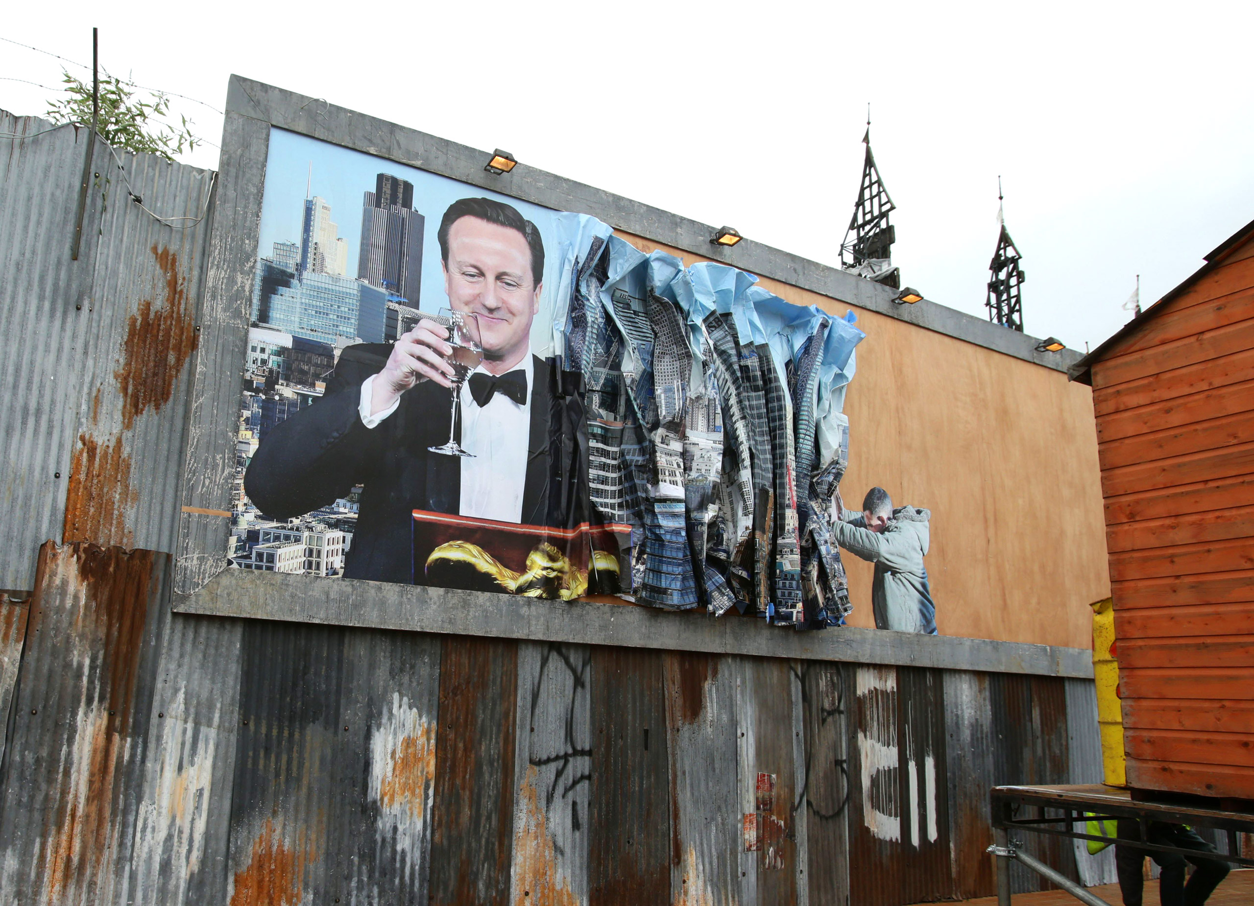 A billboard depicting British Prime Minister David Cameron by Peter Kennard and Cat Phillips.