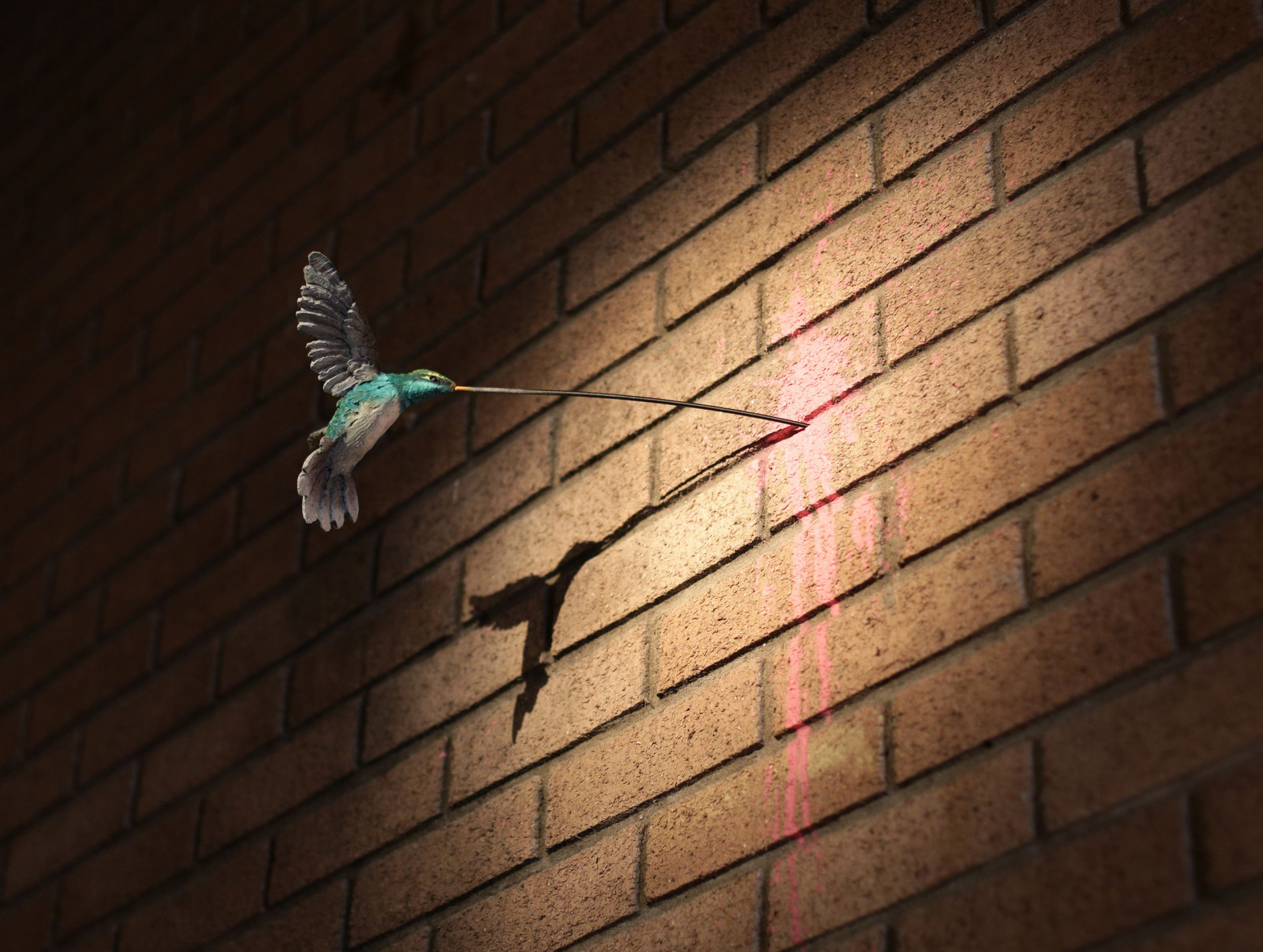A sculpture of a hummingbird by Banksy.