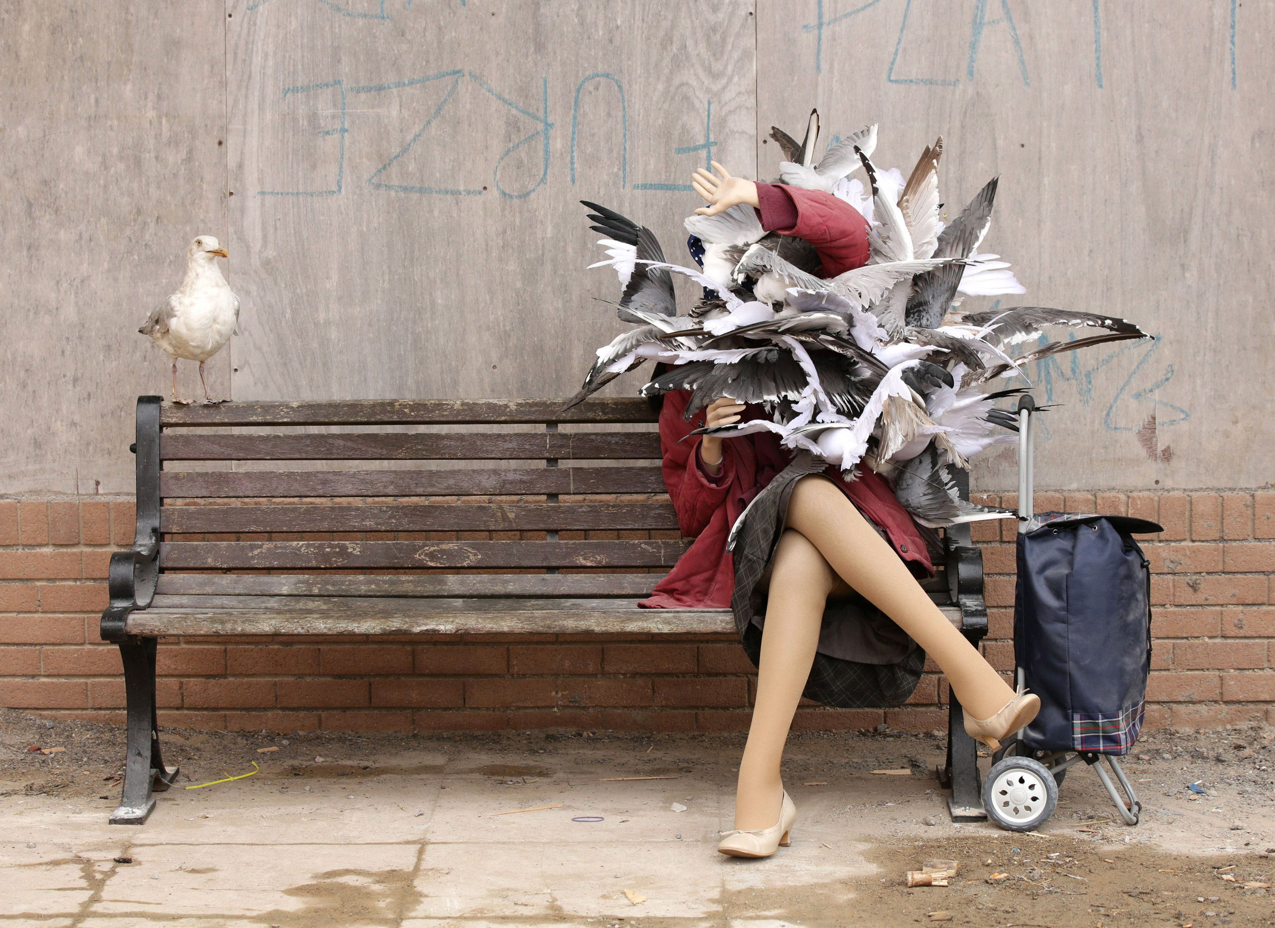 A  sculpture of a woman attacked by seagulls by Banksy .
