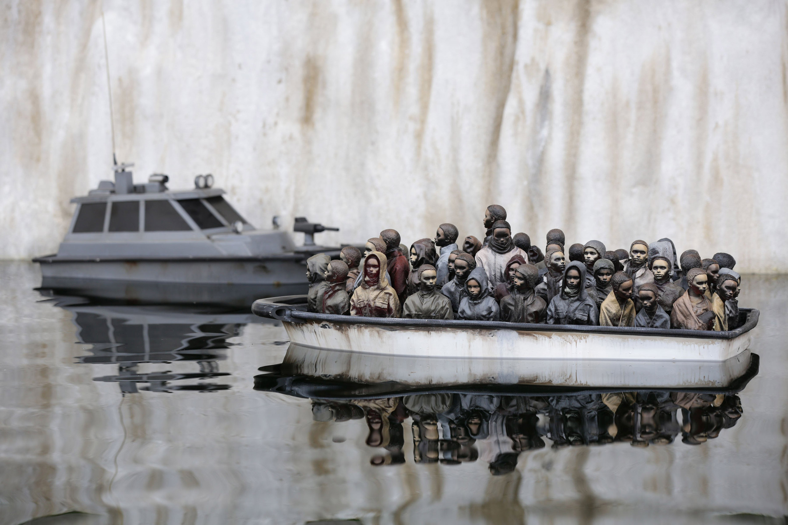A sculpture that appears to reference the migrant crisis by Banksy.