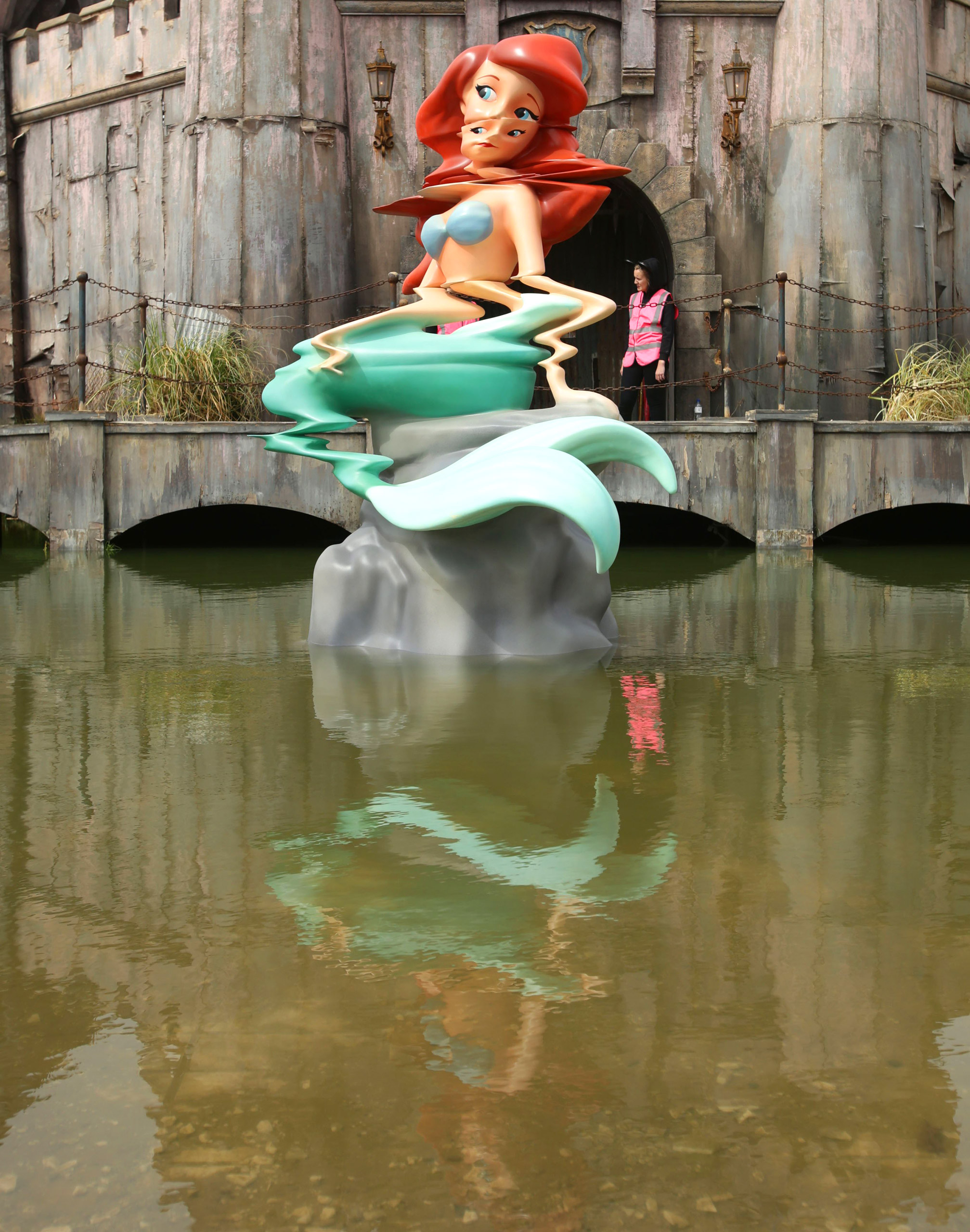 A sculpture of a mermaid reminiscent of Disney's The Little Mermaid by Banksy.