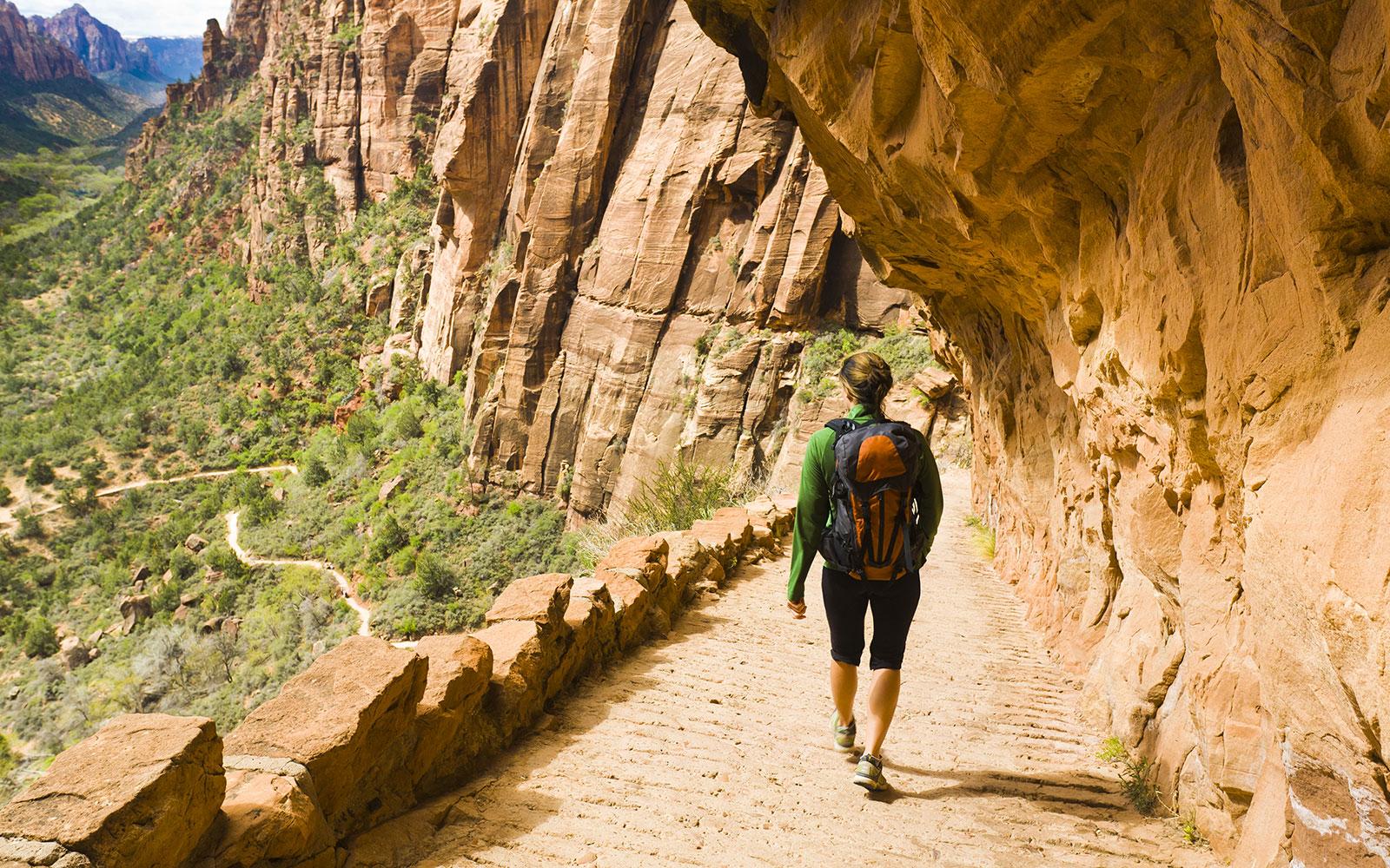woman hiking on canyon path