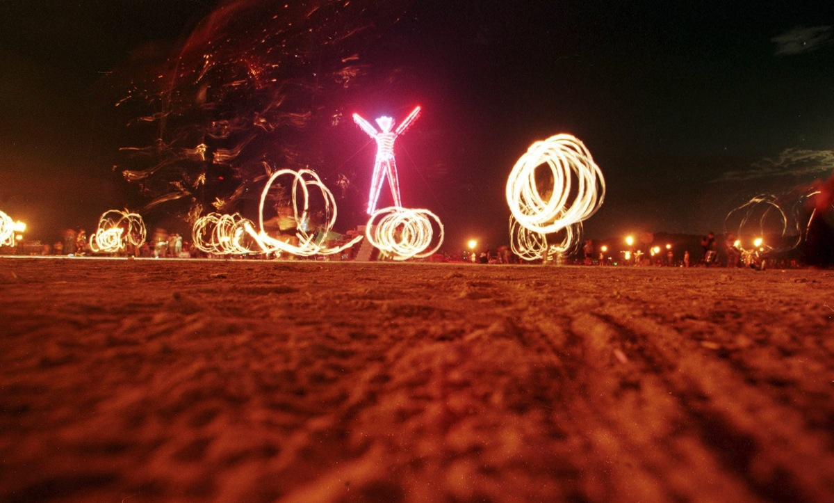 Dancers at the  Burning Man  festival create patterns with fireworks in the Black Rock Desert of Nevada on Sept. 6, 1998.