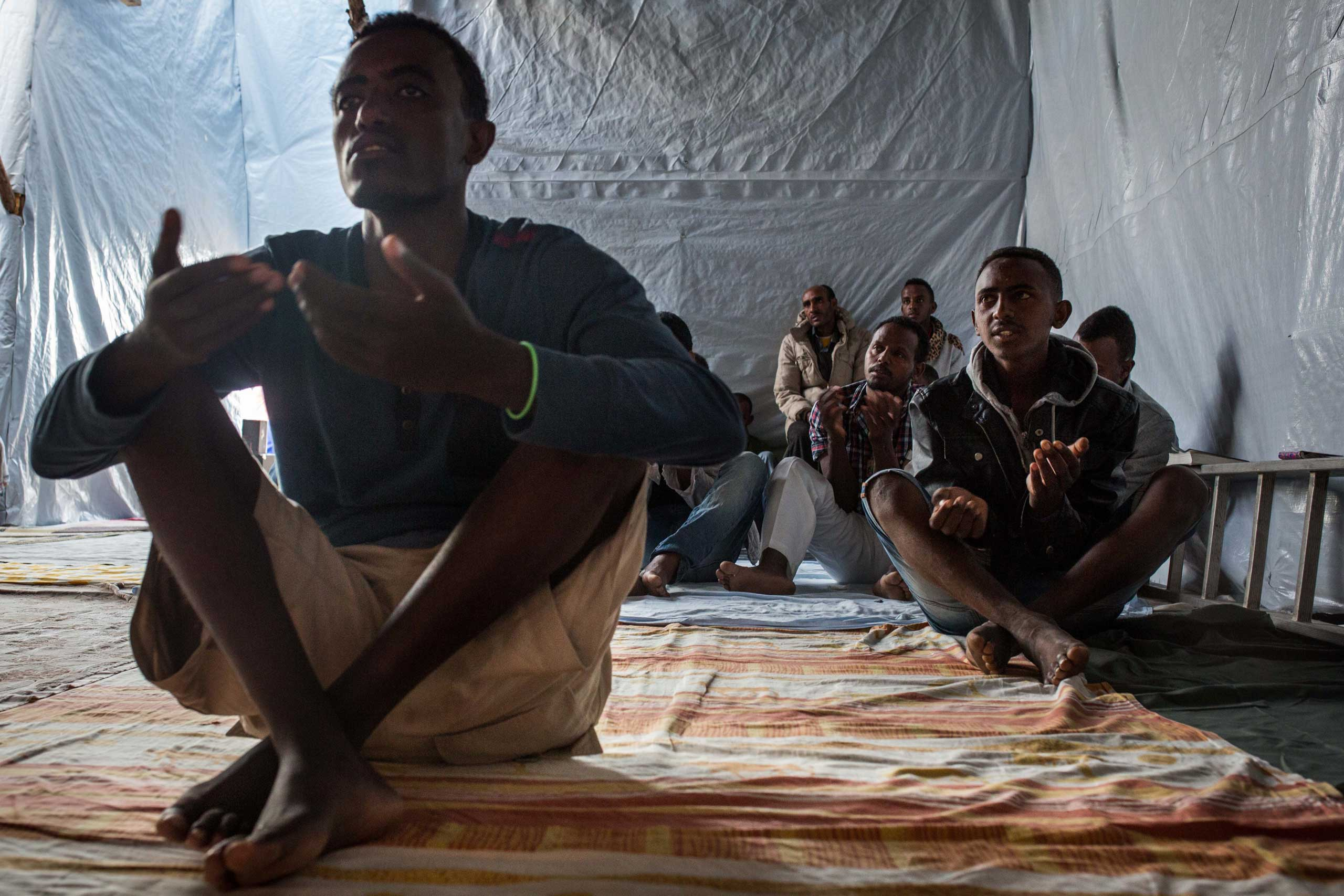 Ethiopian and Eritrean worshippers attend an Orthodox serivce at a church in a make shift camp near the port of Calais, on Aug. 2, 2015.