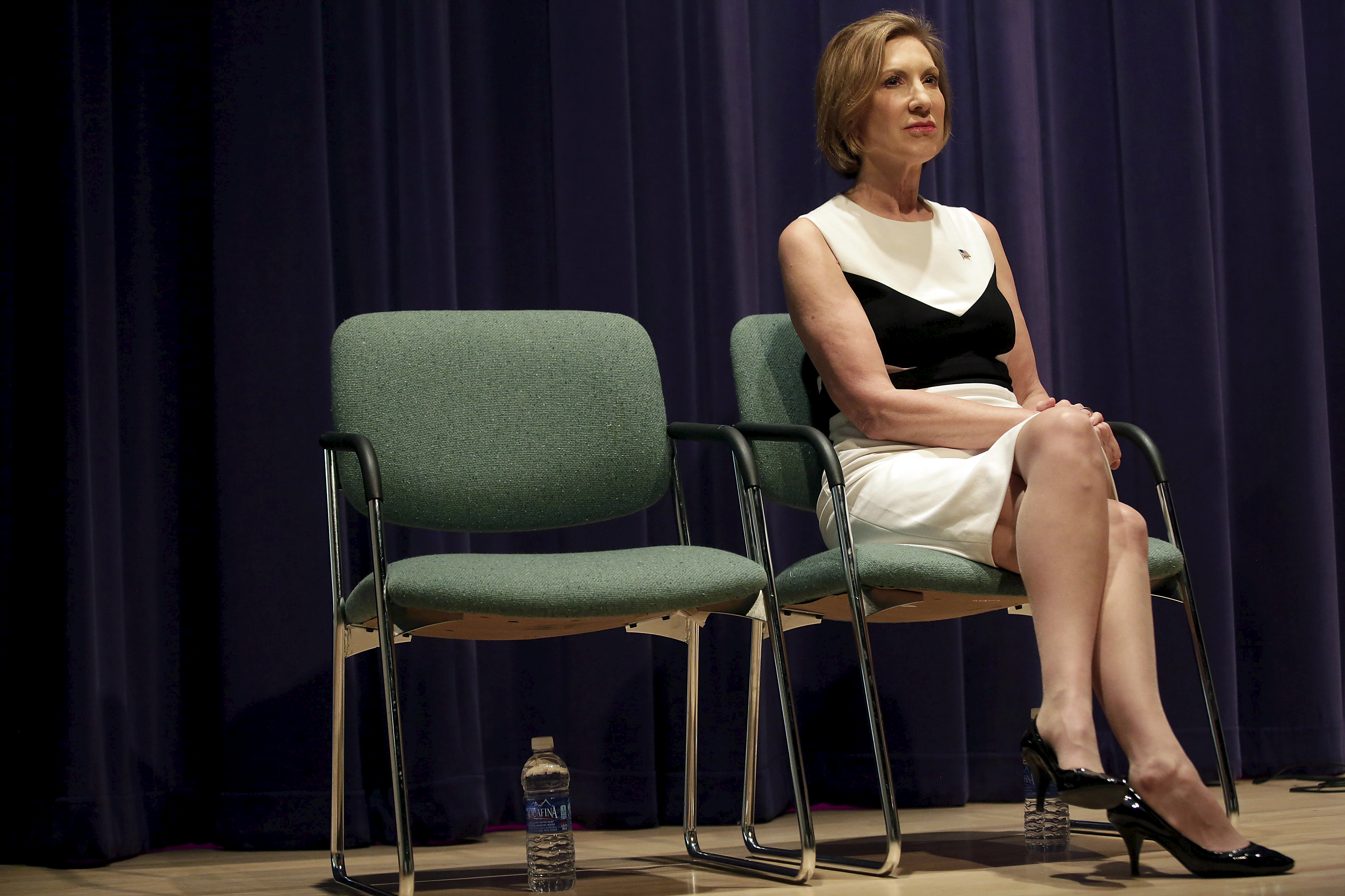 Carly Fiorina waits to be introduced before speaking during a campaign event at the Jewish Federation of Greater Des Moines in Waukee, Iowa on Aug. 16, 2015.