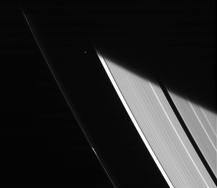 The Cassini spacecraft captures a glimpse of the moon Atlas shortly after emerging from Saturn's shadow on Jan. 23, 2014.
