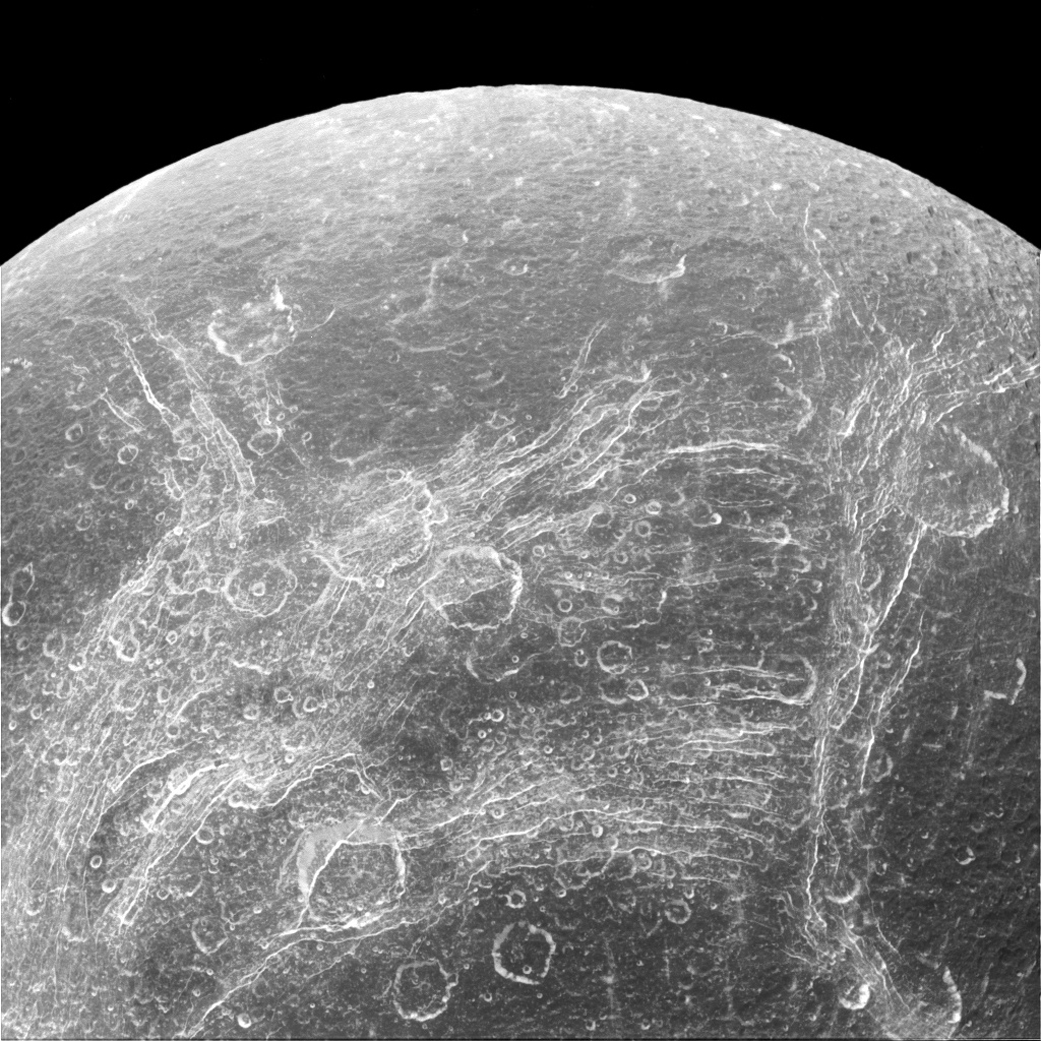 Chasms on Dione.  The image was taken in visible light with the Cassini spacecraft narrow-angle camera on April 11, 2015.
