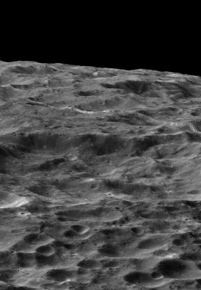 NASA's Cassini spacecraft gazes out upon a rolling, cratered landscape in this oblique view of Saturn's moon Dione. A record of impacts large and small is preserved in the moon's ancient, icy surface.