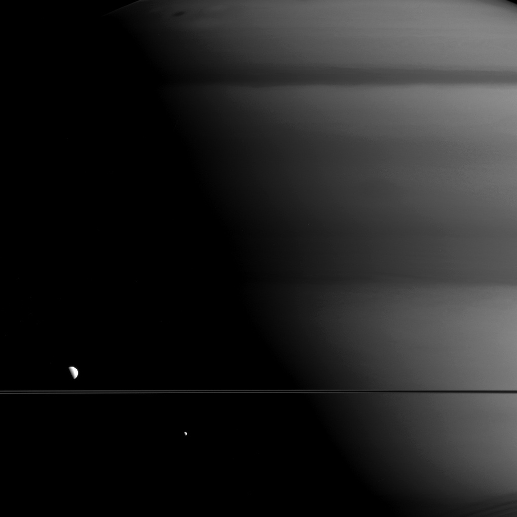 Mimas, Dione and Titan on May 27, 2015. The image is taken using a spectral filter which preferentially admits wavelengths of near-infrared light centered at 728 nanometers