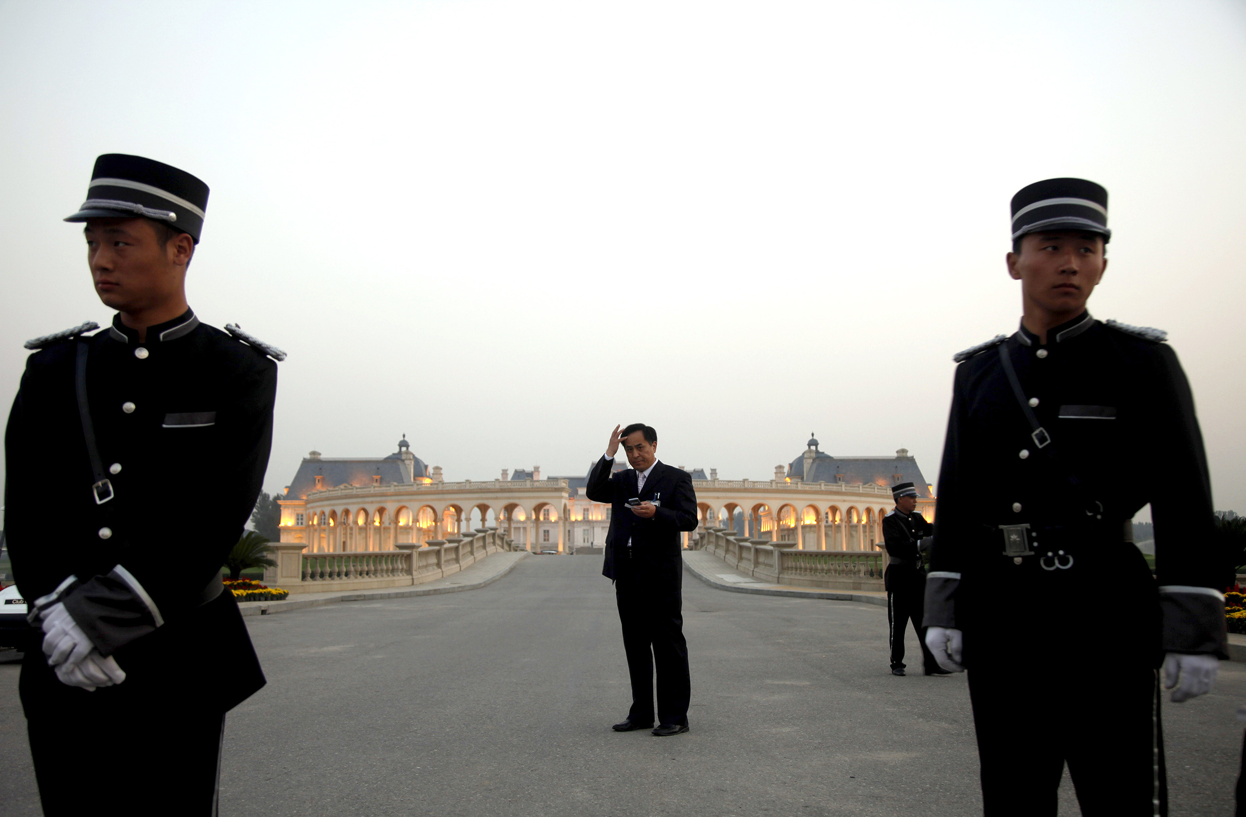 Chinese security personnel wait for guests at a mansion on the edge of Beijing modeled after the baroque 17th century Chateau de Maisons-Laffitte in France.