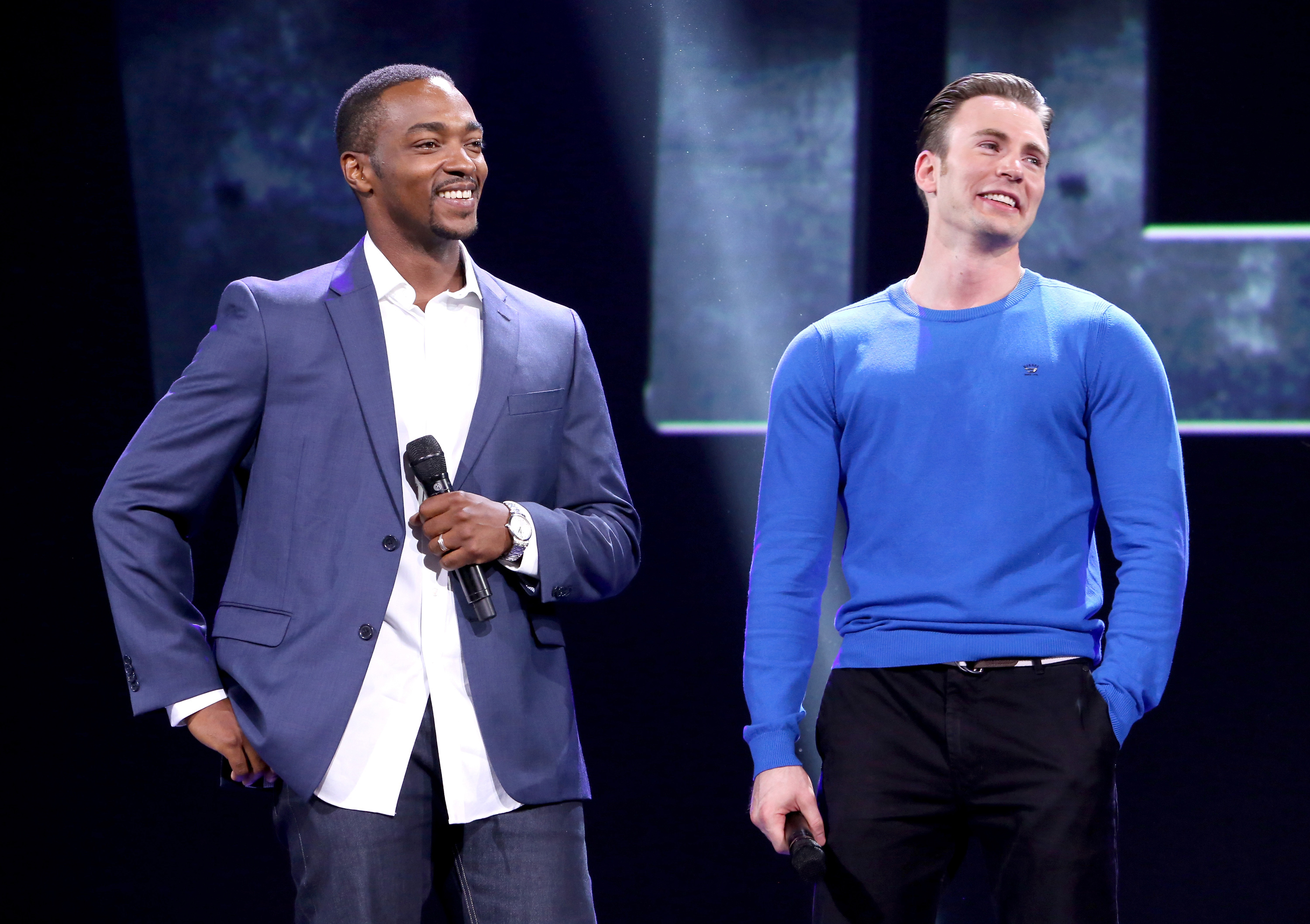 Actors Anthony Mackie, left, and Chris Evans of CCaptain America: Civil War took part in  Worlds, Galaxies, and Universes: Live Action at The Walt Disney Studios  presentation at Disney's D23 EXPO 2015 in Anaheim, Calif., on Aug. 15, 2015.
