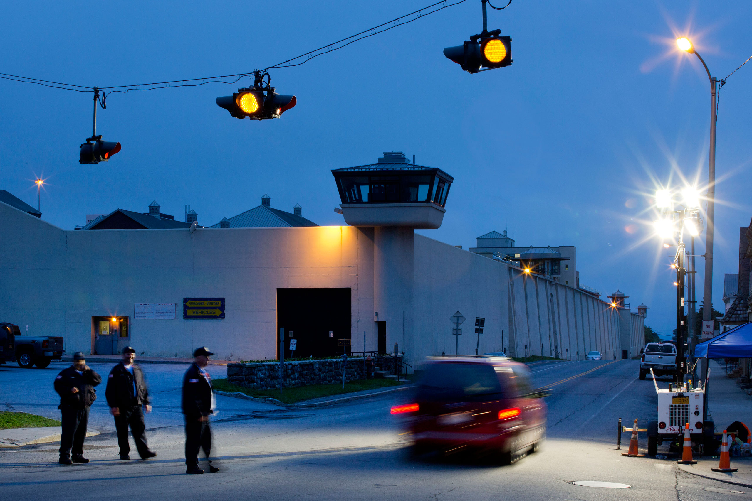 Corrections officers watch an intersection in front of Clinton Correctional Facility in Dannemora, N.Y., on June 15, 2015.