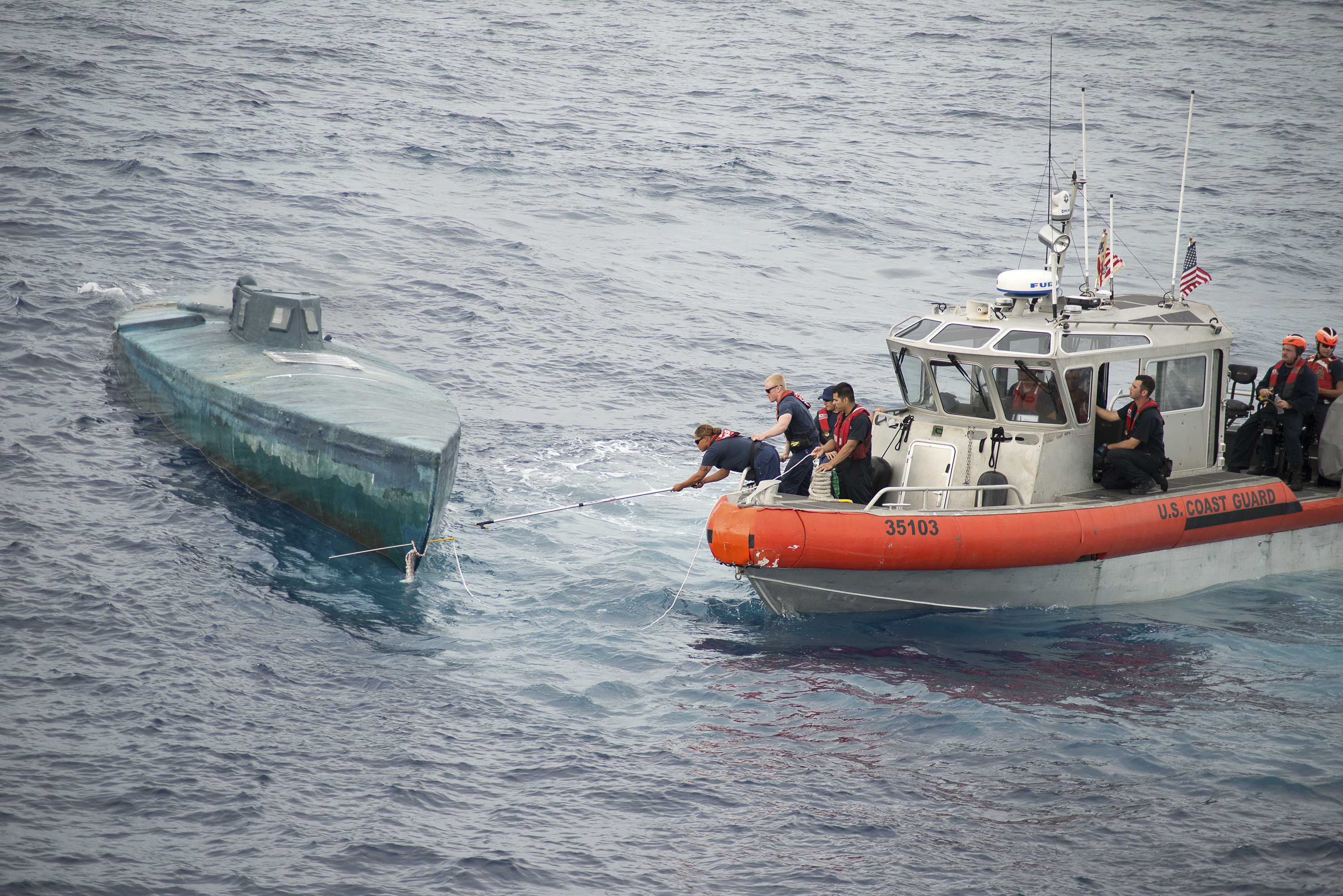 Crew from the U.S. Coast Guard Cutter Stratton stop a Self-Propelled Semi Submersible off the coast of Central America in this U.S. Coast Guard picture taken July 18, 2015 and released August 5, 2015.