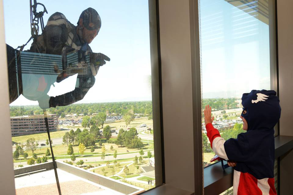 Members of the Aurora Police Department of Colorado dressed up as superheroes for the children at Colorado Children Hospital on Aug. 13, 2015 in Aurora, Colo.