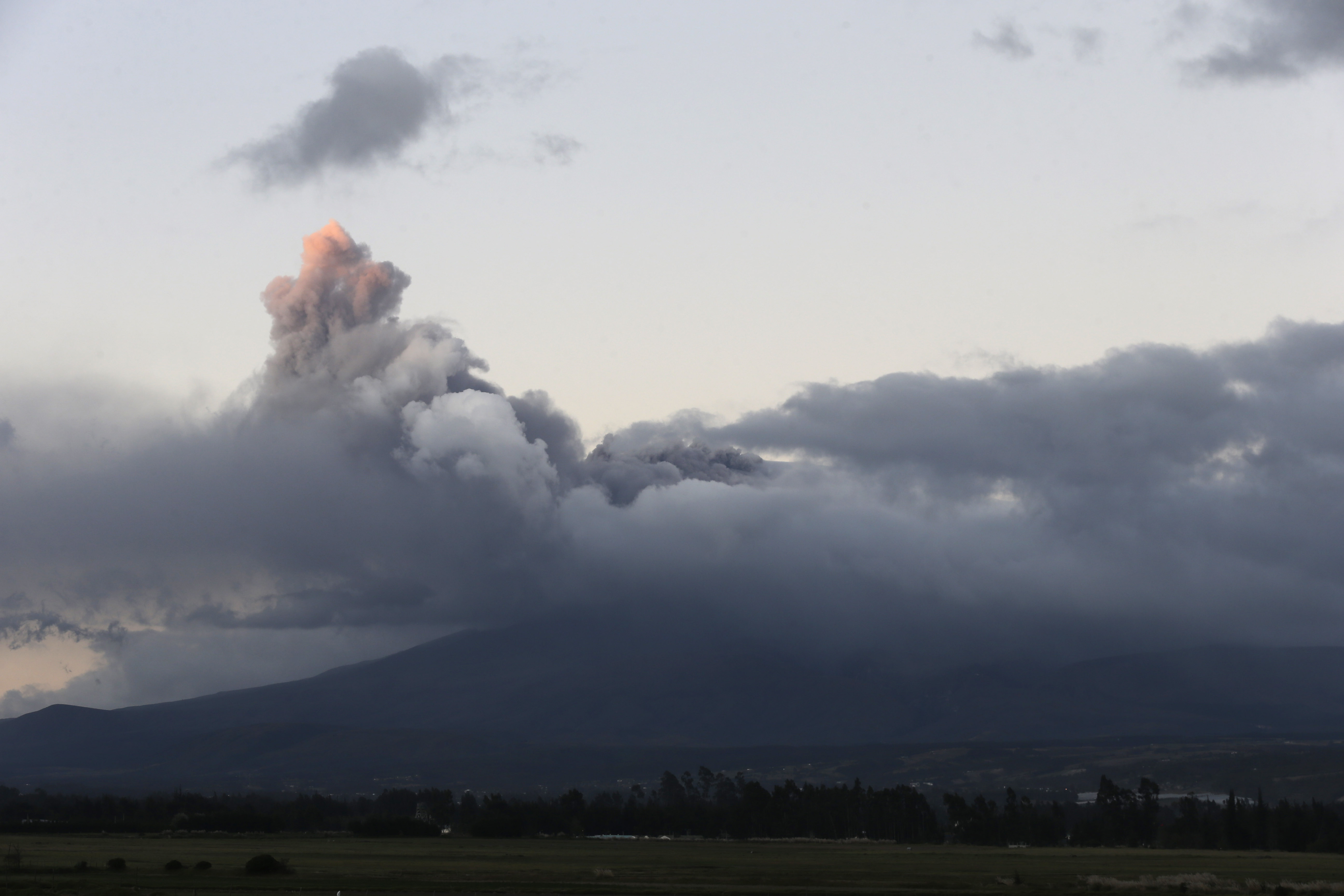 A view of Cotopaxi volcano spewing ashes as seen from Latacunga, Ecuador on Aug. 15, 2015.