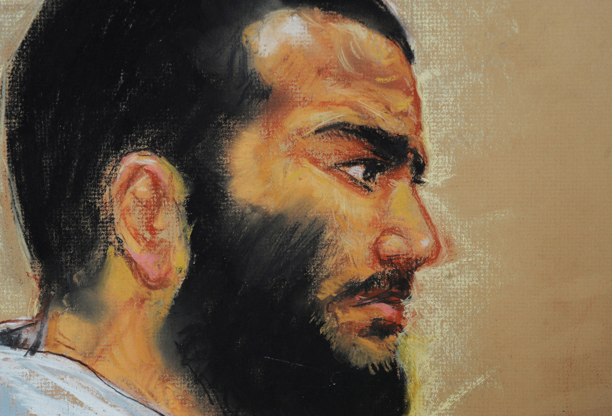 Canadian-born accused terrorist Omar Khadr attends a pre-trial session in Camp Justice on the U.S. Naval Base in Guantanamo Bay on Dec. 12, 2008. Khadr, the youngest prisoner held in Guantanamo Bay at the time at age 15, accepted an eight-year sentence.