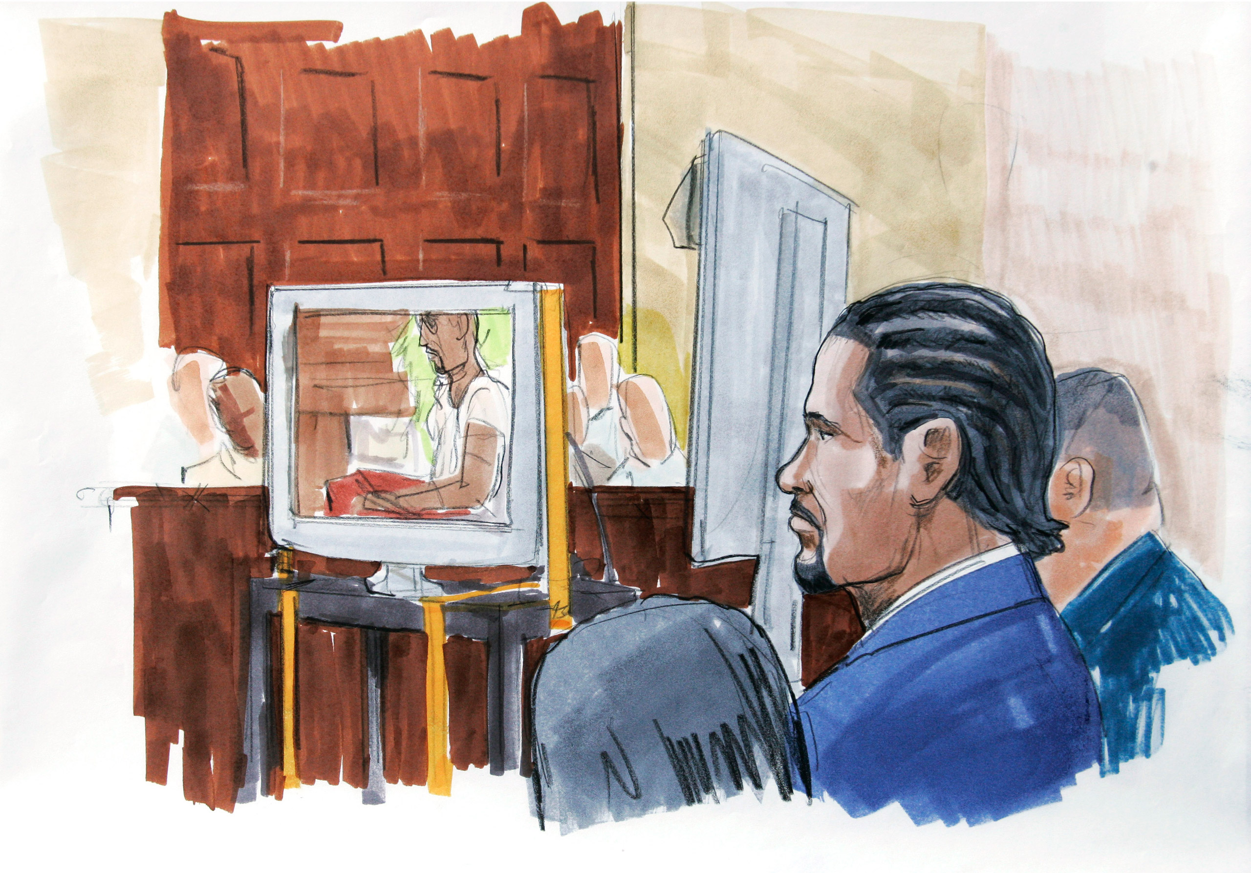 R. Kelly watches in court as prosecutors played the sex tape at the center of his child pornography trial in open court in Chicago on May 20, 2008. Kelly was found not guilty of all counts.