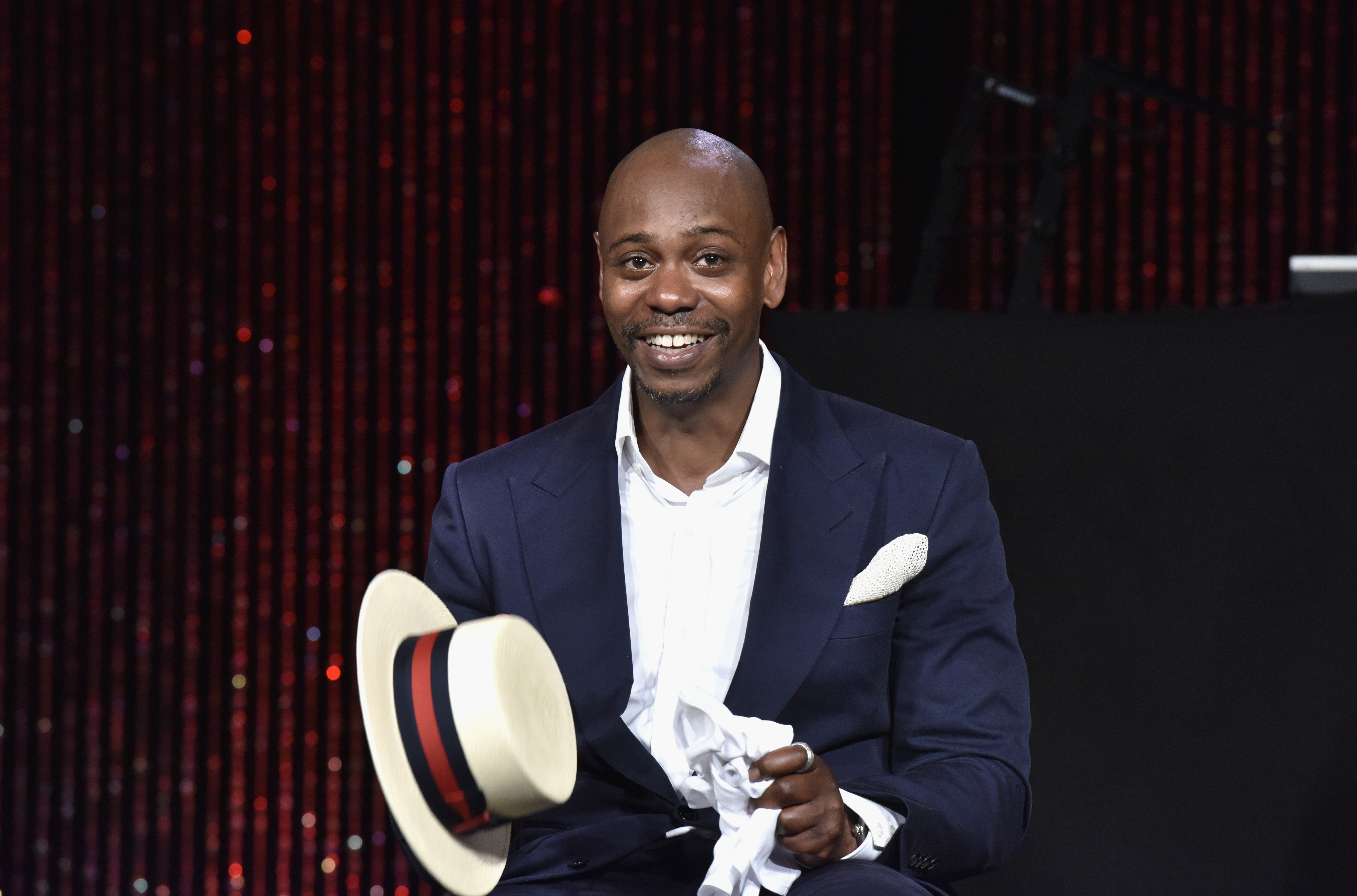 Dave Chappelle speaks on stage as RUSH Philanthropic Arts Foundation Celebrates its 20th Anniversary at Fairview Farms on July 18, 2015 in Water Mill, New York.