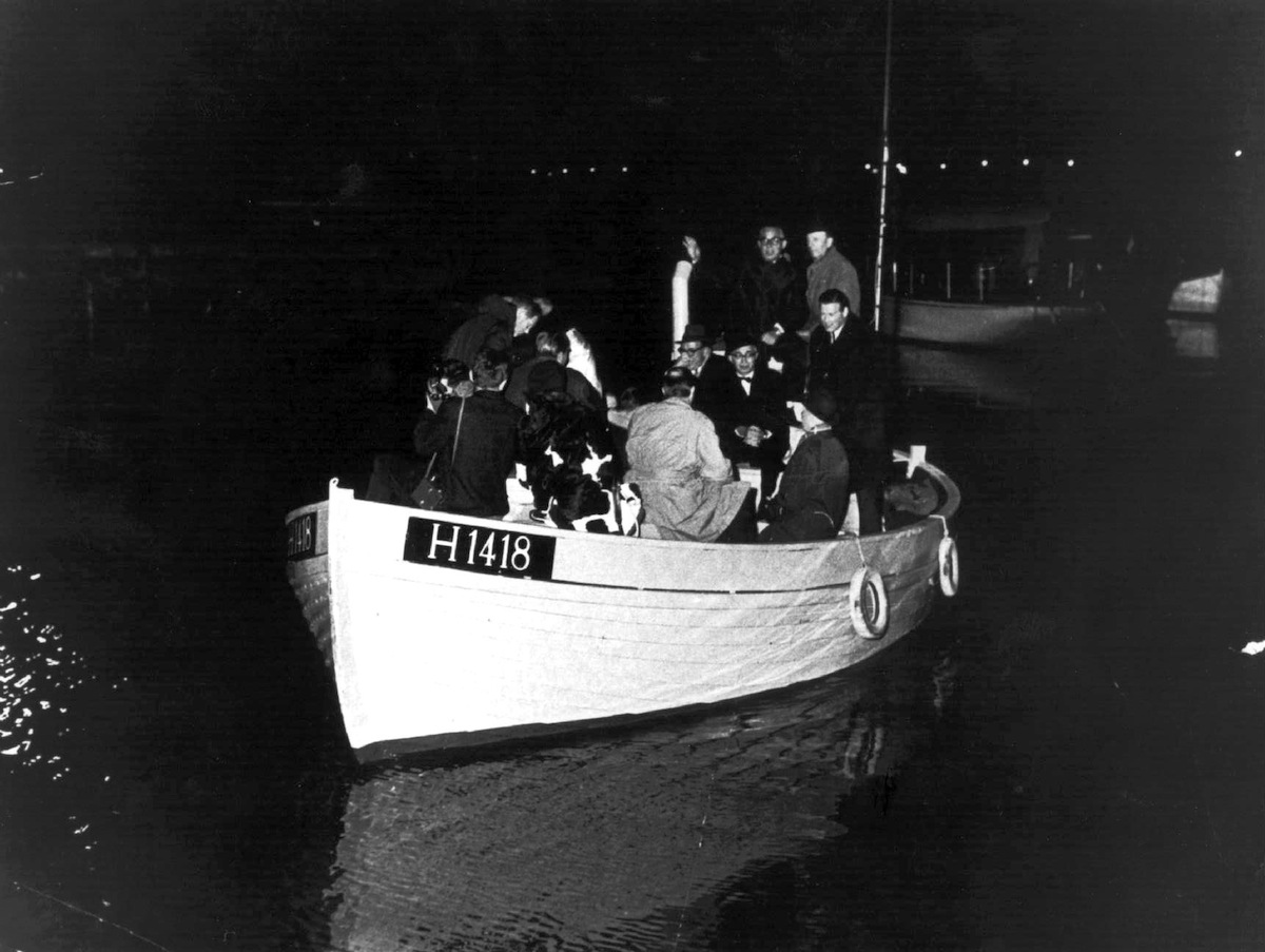This 1943 photo shows a boat carrying people during the escape across the Oresound of some of 7,000 Danish Jews who fled to safety in neighboring Sweden