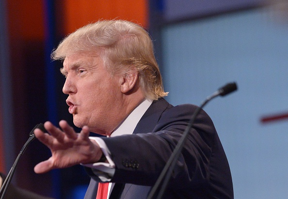 Real estate tycoon Donald Trump speaks during the prime time Republican presidential debate on August 6, 2015 at the Quicken Loans Arena in Cleveland, Ohio.