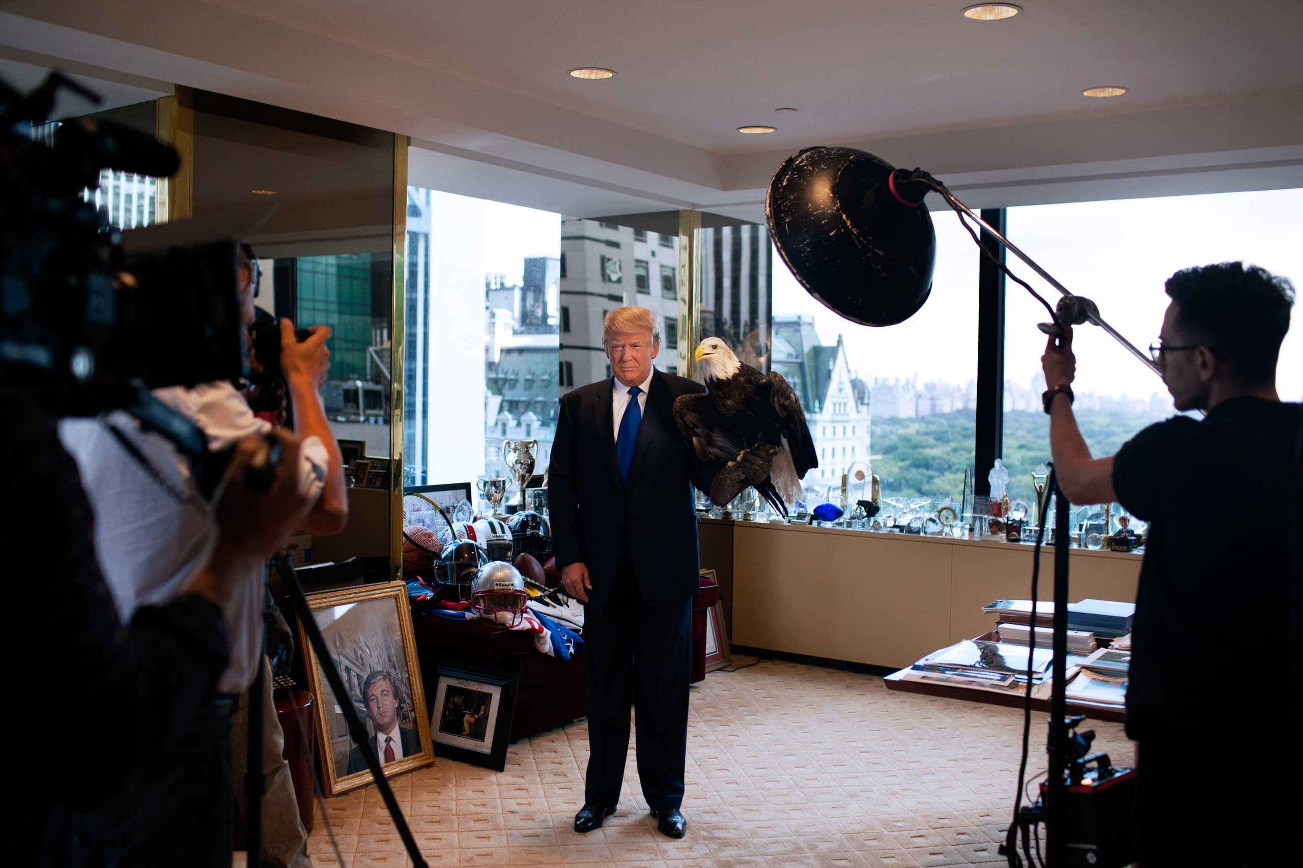 Photographer Martin Schoeller photographs Donald Trump in his corner office on the 25th floor of Trump Tower in New York City, with a bald eagle named Uncle Sam.