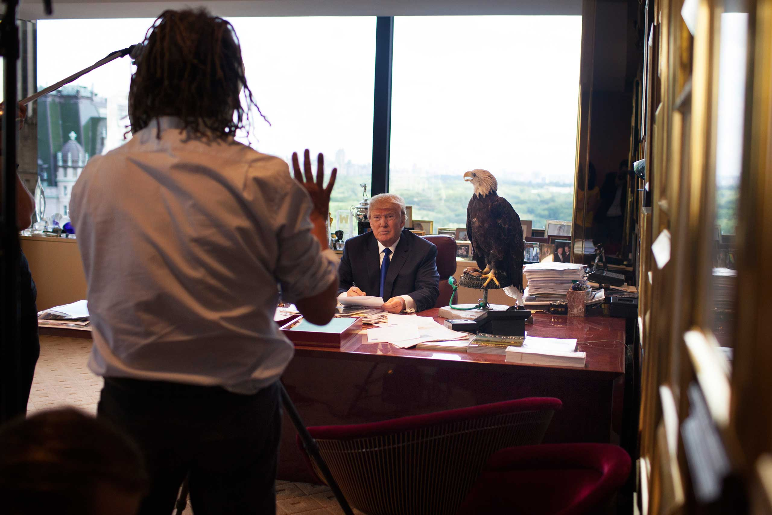 Photographer Martin Schoeller talks with Donald Trump in his office in New York City.