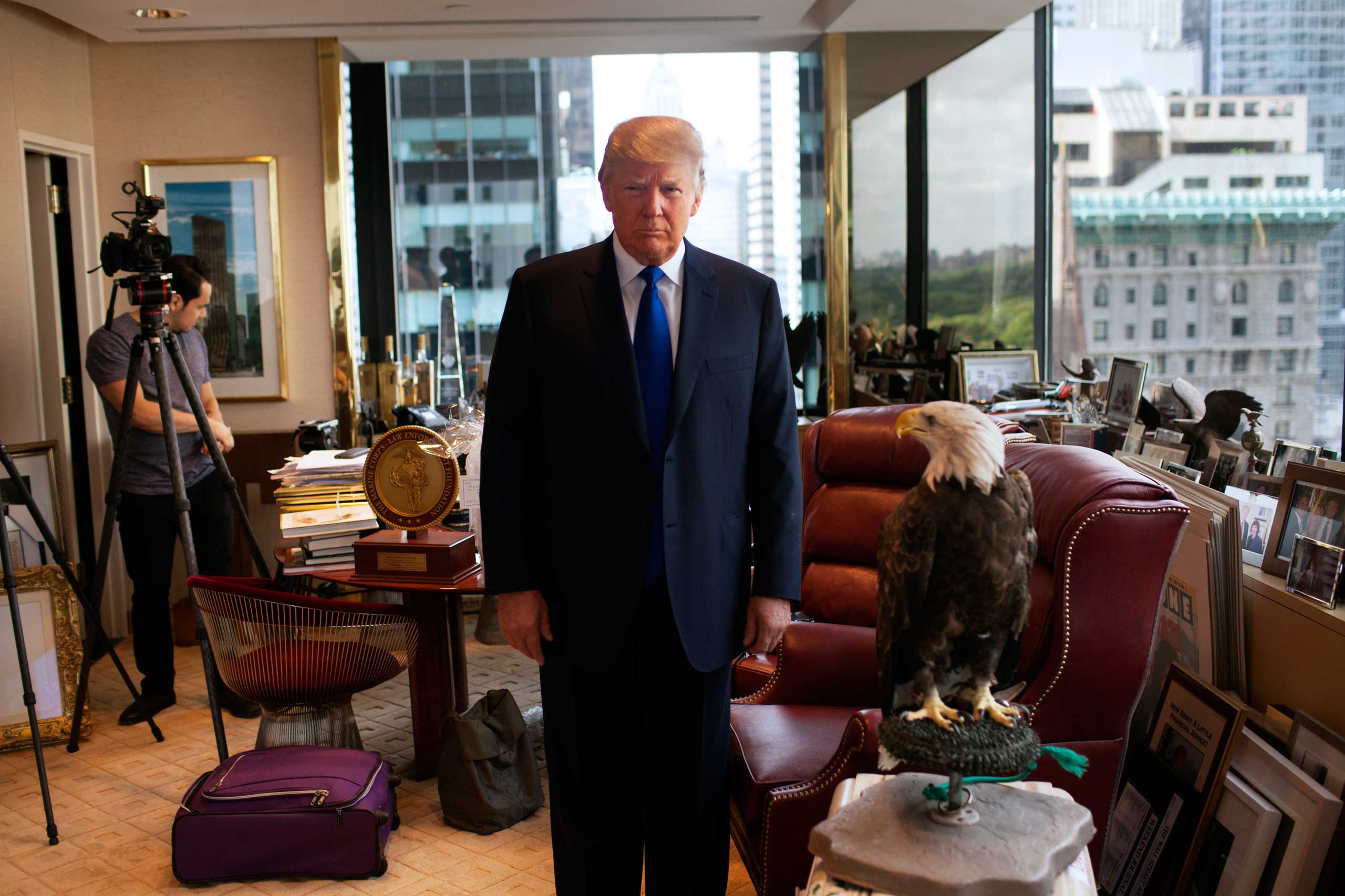 Donald Trump poses with Uncle Sam, an American bald eagle, in his office in New York City.