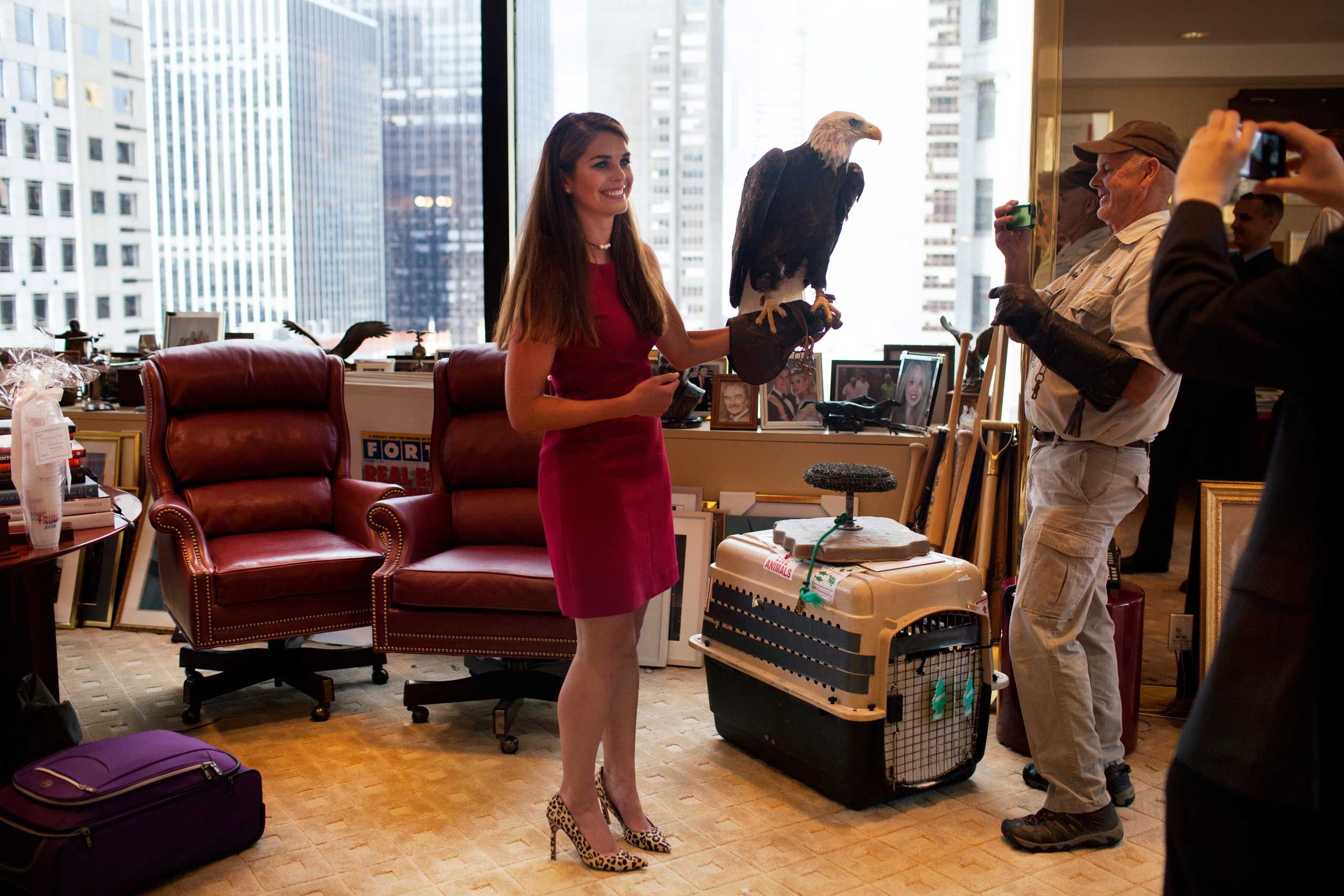 Donald Trump's campaign communications manager Hope Hicks holds Uncle Sam, an American bald eagle.