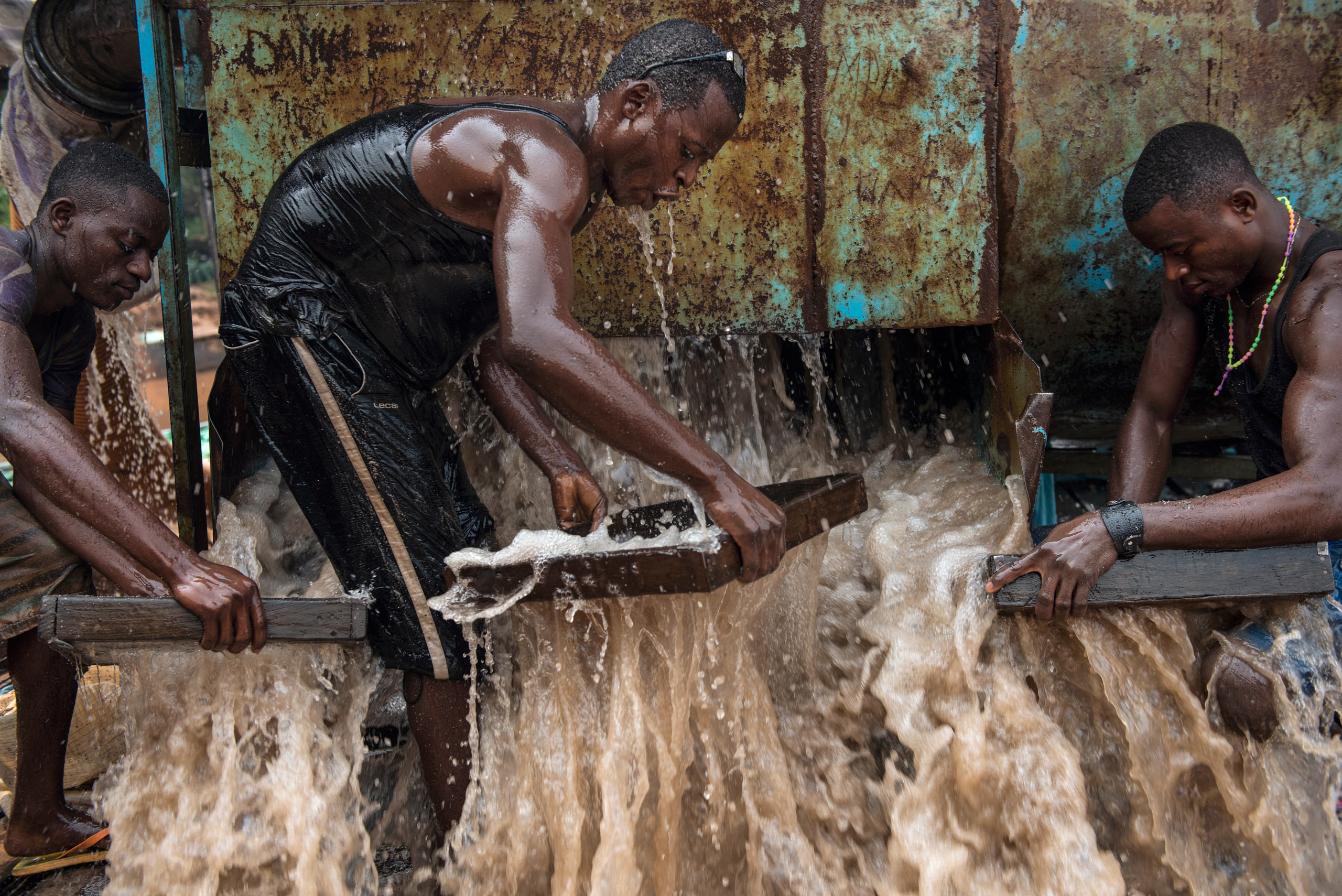 Congolese miners pump gravel from riverbeds to search for diamonds. They earn money only when they find one. Democratic Republic of Congo. Aug. 6, 2015.