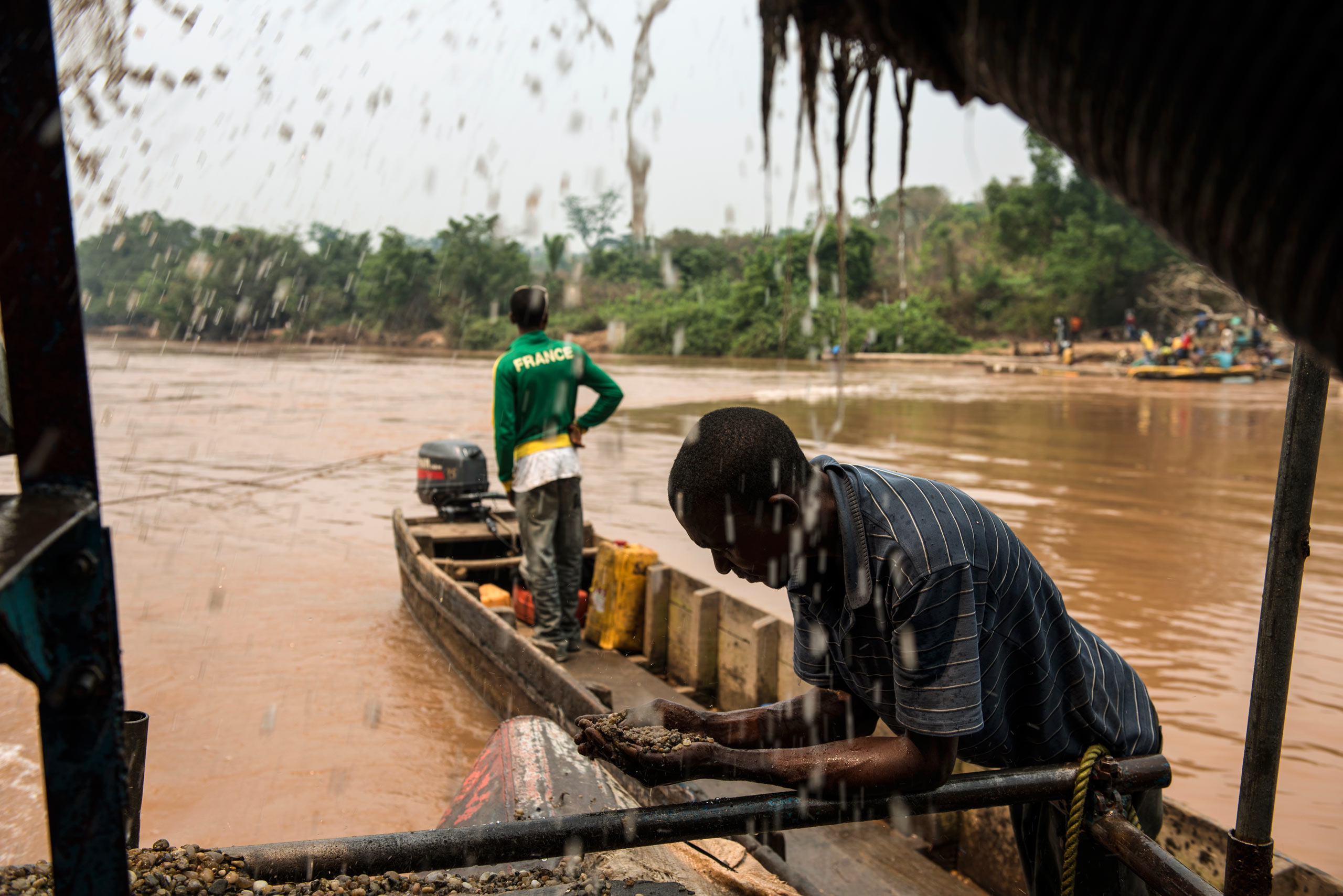 Congolese workers search for rough diamonds in a  semi-industrialised diamond digging site along a river in the Democratic Republic of Congo. Aug. 6, 2015.