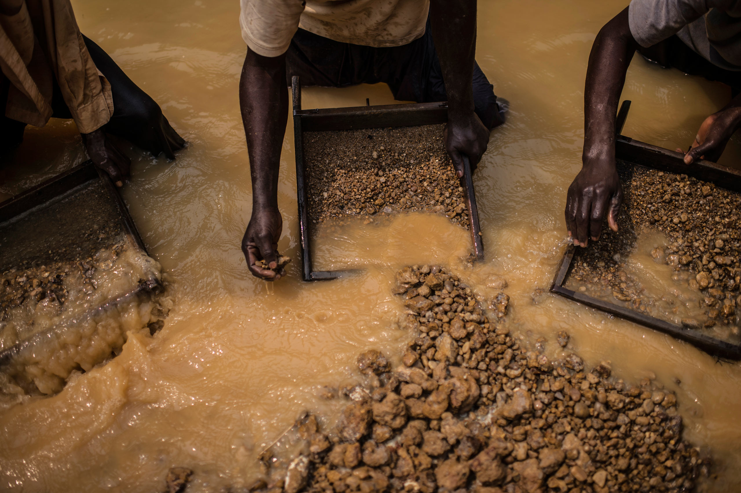 Congolese workers search for rough diamonds in a mine  in the southwest region in the Democratic Republic of Congo. Aug. 9, 2015.