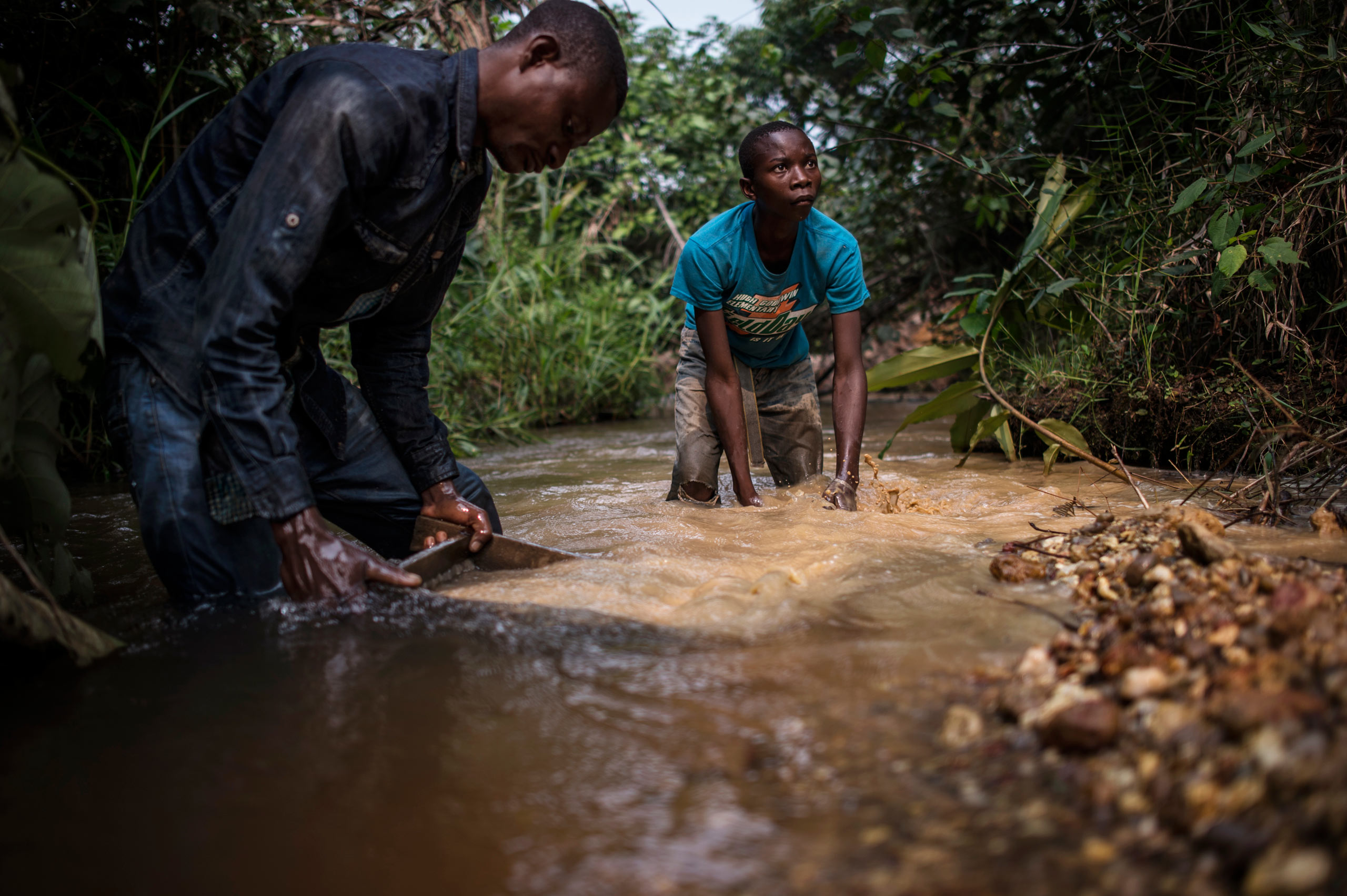 Mbuyi Mwanza, 15, spends his days shoveling and sifting gravel in the small artisanal mines of southwest Democratic Republic of Congo, Aug. 9, 2015.