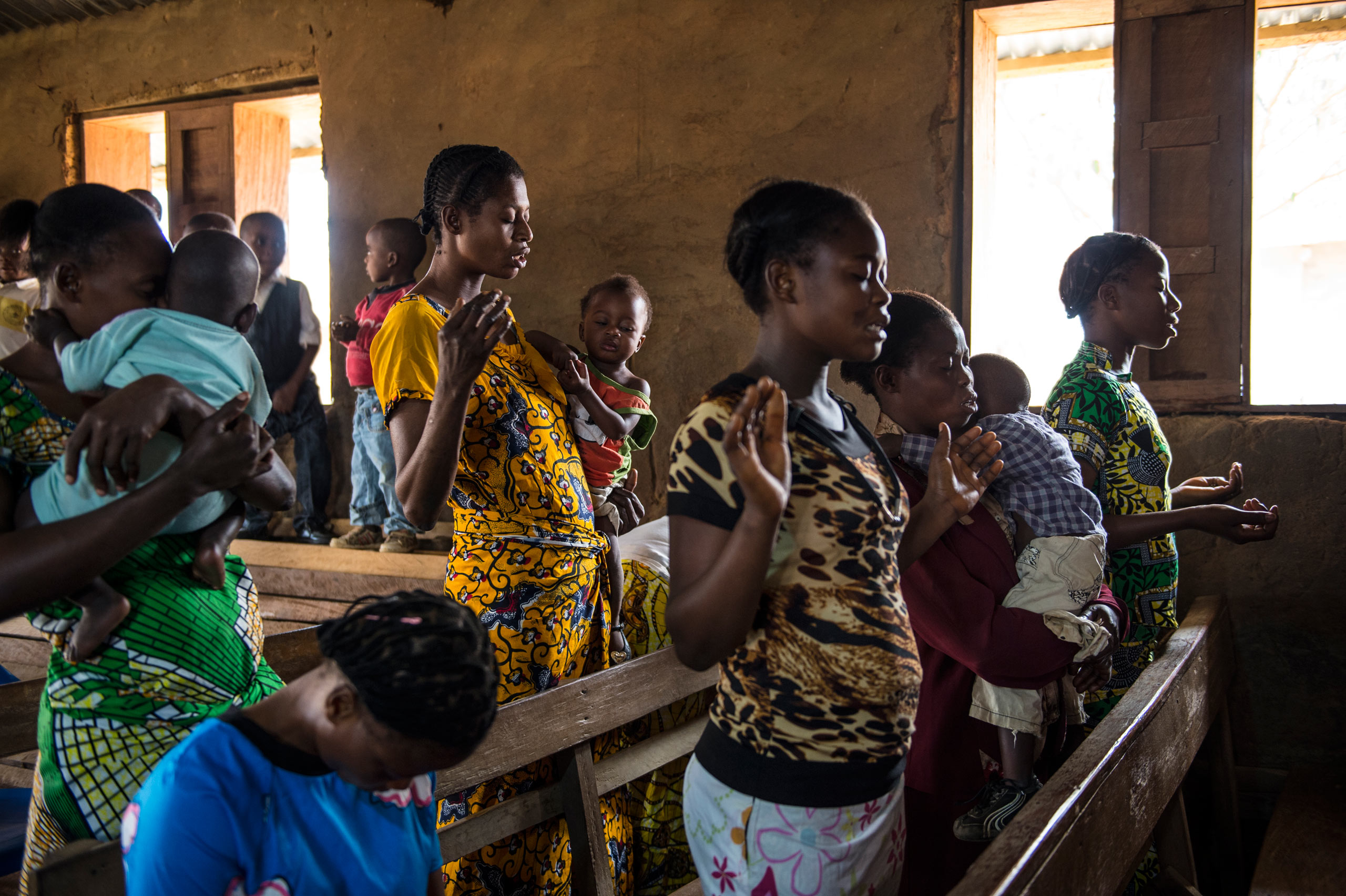 Families attend Sunday church mass in Kamabue, in the heart of Congo's diamond-mining region. Aug. 9, 2015.