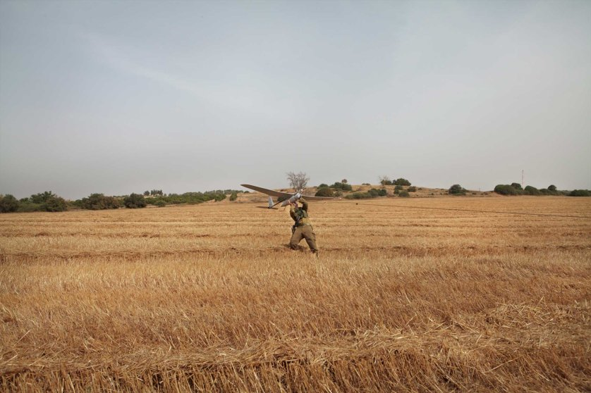 An Israeli soldier from the Sky Rider Unit launches a Skylark mini-Unmanned Arial Vehicle (UAV) during a demonstration close to the border with Gaza. u2028u2028Sky Rider units are part of the artillery brigade and operate on the ground either independently or with other infantry soldiers to provide real-time video from the battlefield. The Israeli military began using the Skylark system in 2008 but it was not deployed extensively until Operation Protective Edge in the summer of 2014. u2028u2028The Sky Rider unit lives with the infantry soldiers they serve with and support during their missions, unlike pilots in the Israeli Air Force (IAF) who fly larger drones and are stationed on bases far away from where the drones fly.u2028u2028The drone is built by the Israeli company Elbit Systems. It weighs around 7 kilograms and can stay in the air for up to 3 hours. It's used for intelligence, surveillance and reconnaissance (ISR) missions.