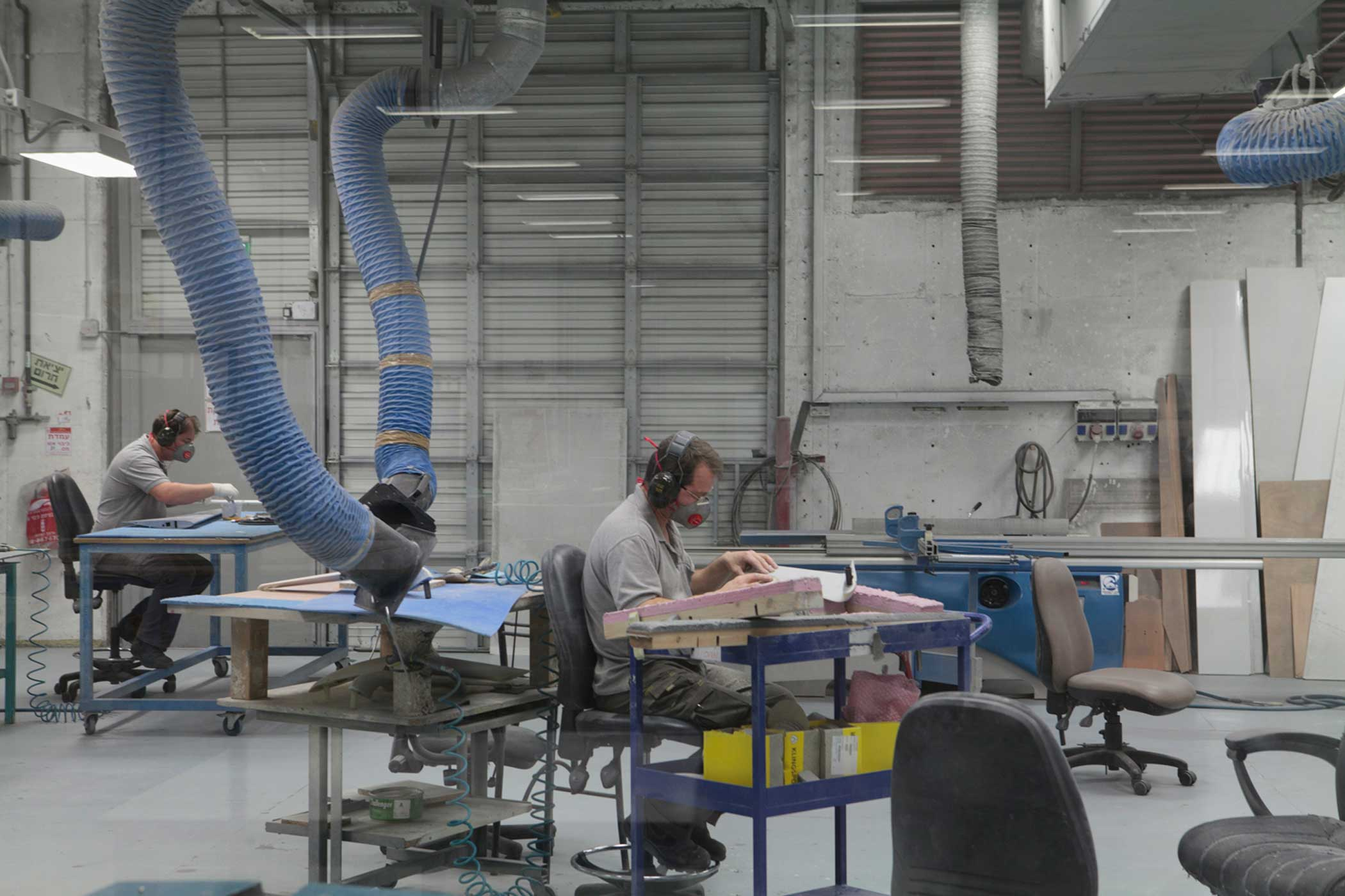 Employees working on airframe components inside the Aeronautics factory in Yavne, Israel.                                                               The bodies of modern UAVs are mostly made up of composite materials. At the Aeronautics factory, workers employ a series of labor-intensive processes in which thin sheets of composite materials are combined to create solid pieces of the drone's airframe.