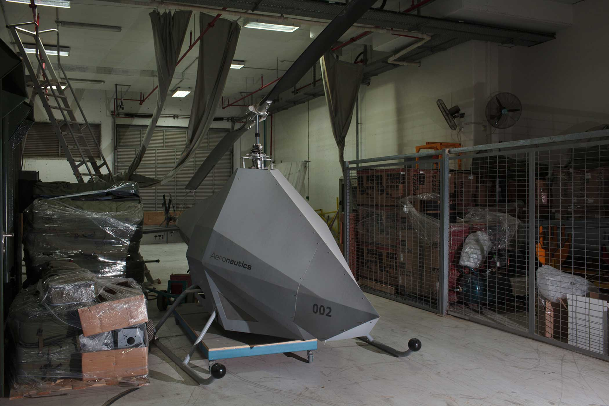 A prototype of the Picador, a VTOL (vertical take off and landing) UAV, sitting in a storage area inside the Aeronautics factory.in Yavne, Israel.