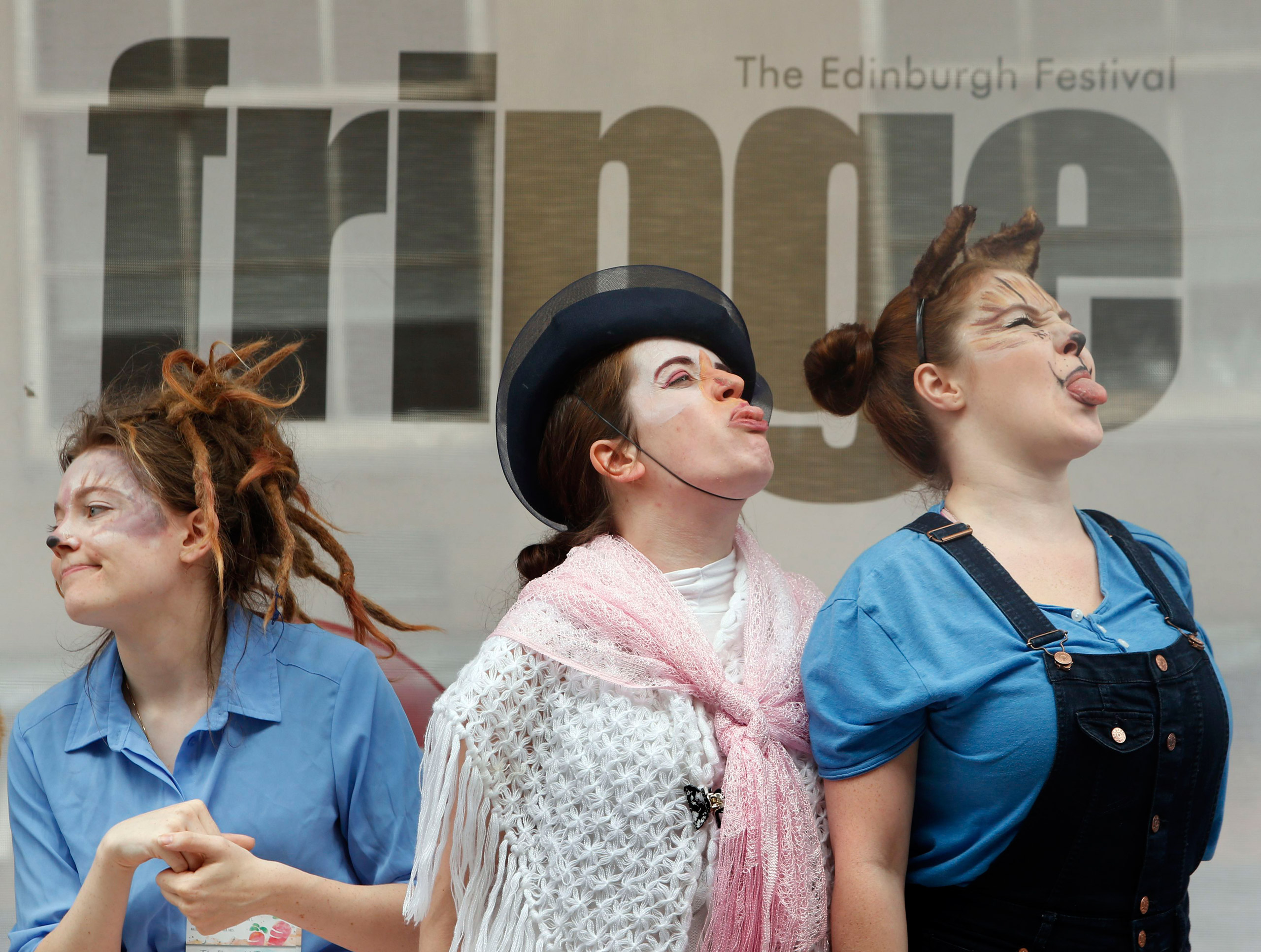 Performers from The Emerald Theatre promote their Edinburgh Festival Fringe show on the Royal Mile in Edinburgh on Aug. 24, 2015.